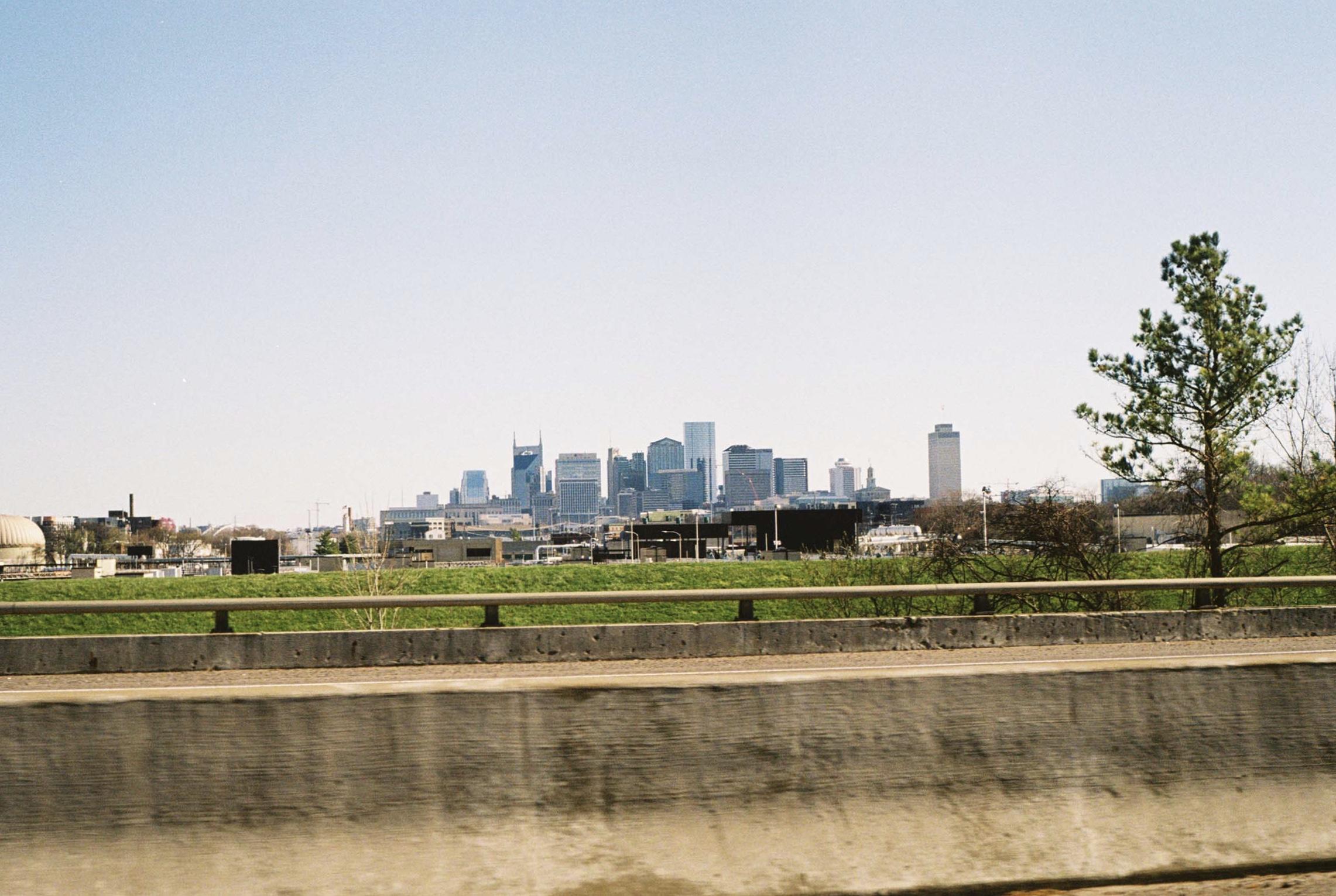 Downtown off in the distance.  Nashville, Tennessee.  Kodak Ultra Max 400. Pentax K1000. Fletcher Berryman 2019.