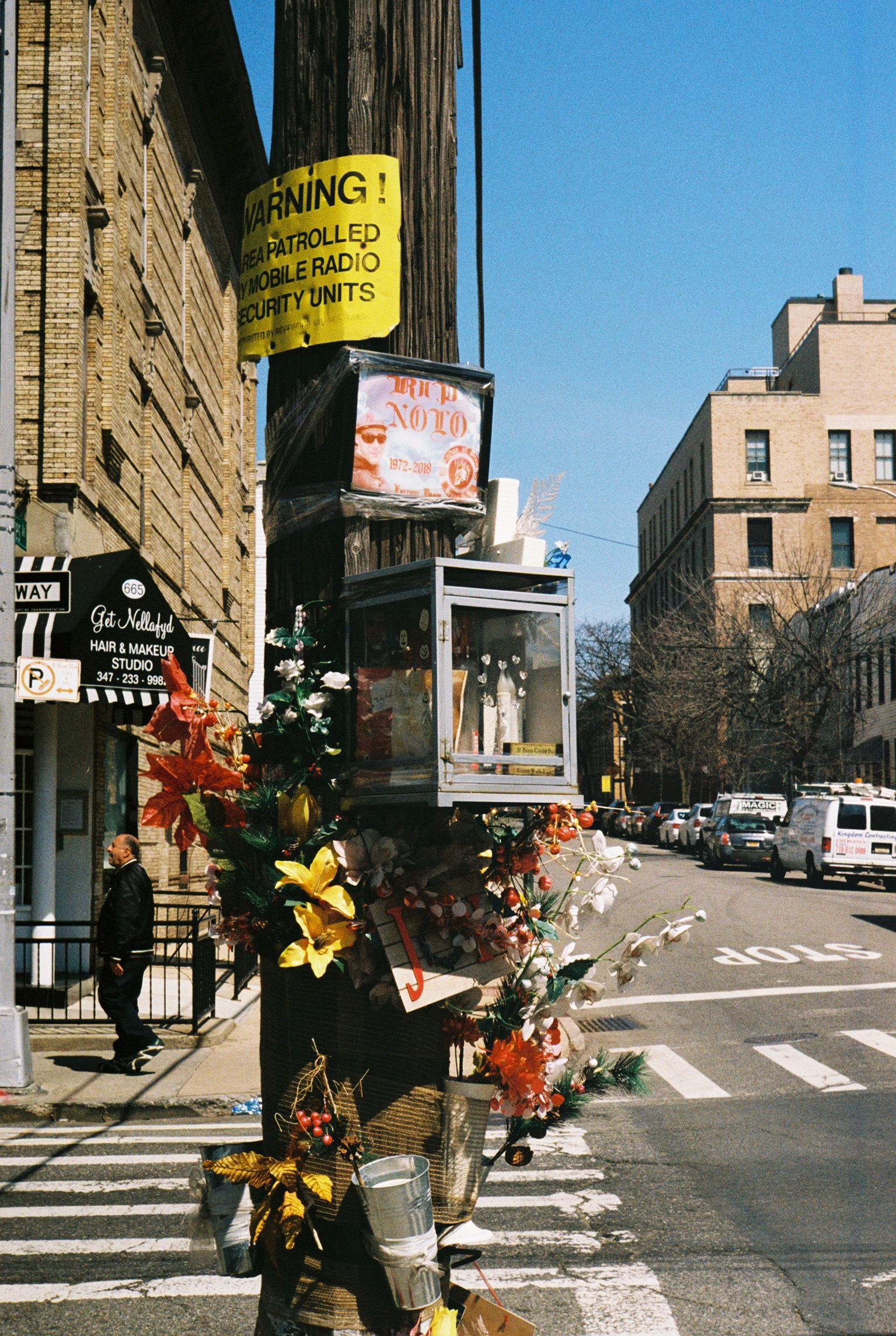 A makeshift memorial to a passed-on resident.  Ridgewood, Queens.  Kodak Portra 800. Pentax K1000. Fletcher Berryman 2019.