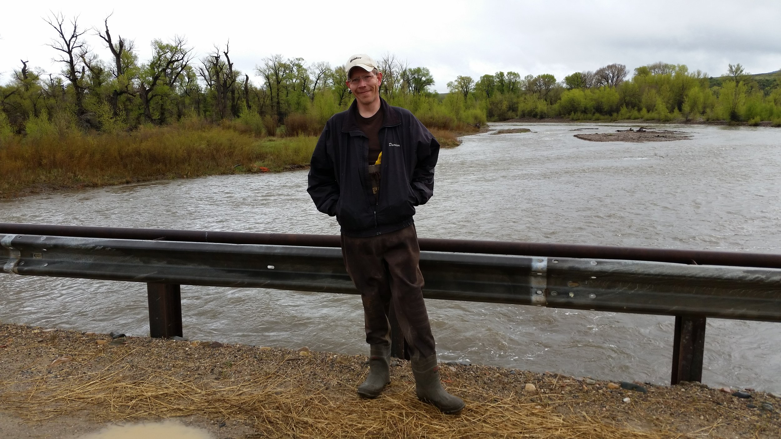 Damien Willis stands on a bridge over the Little Snake River near Dixon, WY.