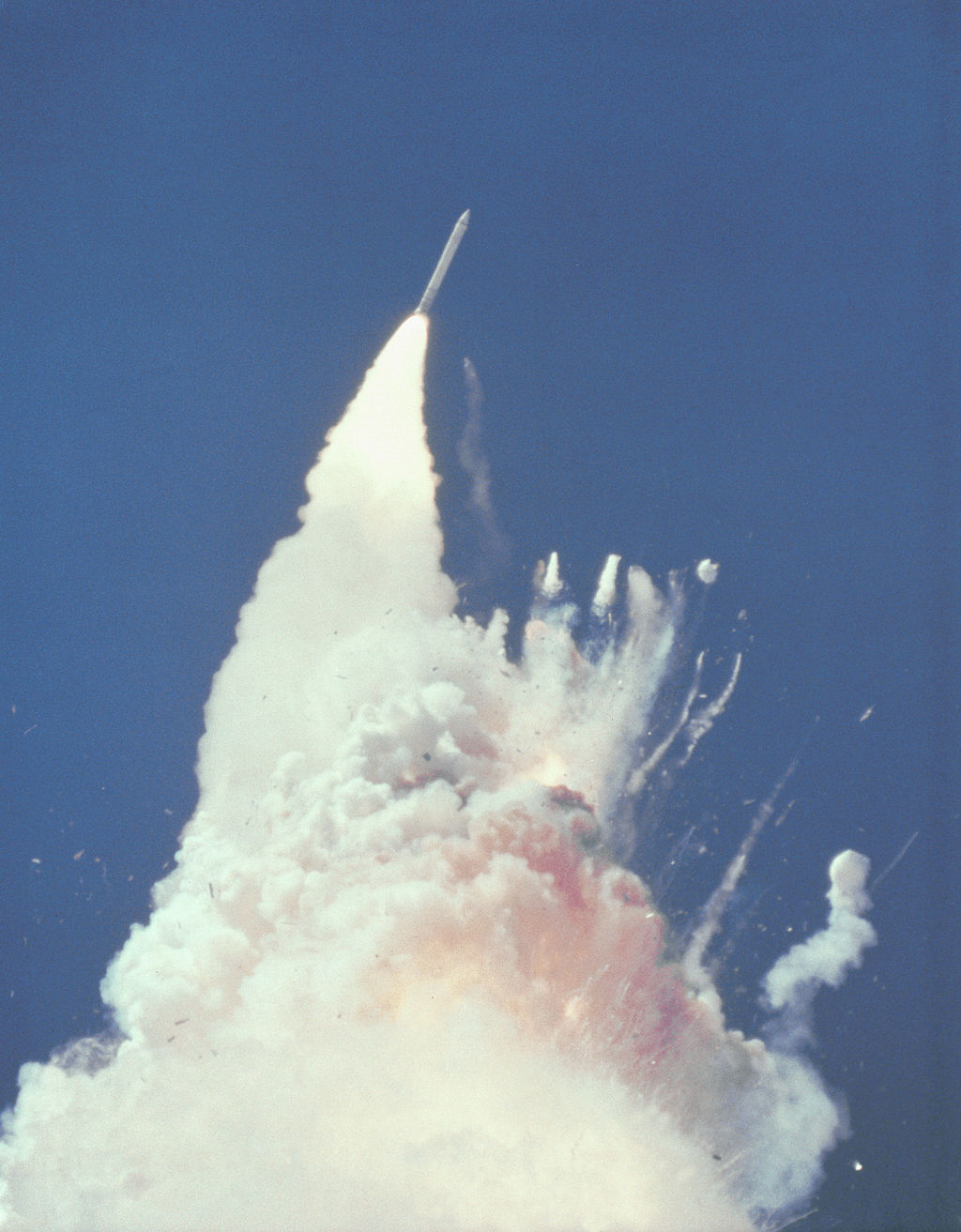 The shuttle Challenger explodes. [Source:    Wikimedia Commons   ]