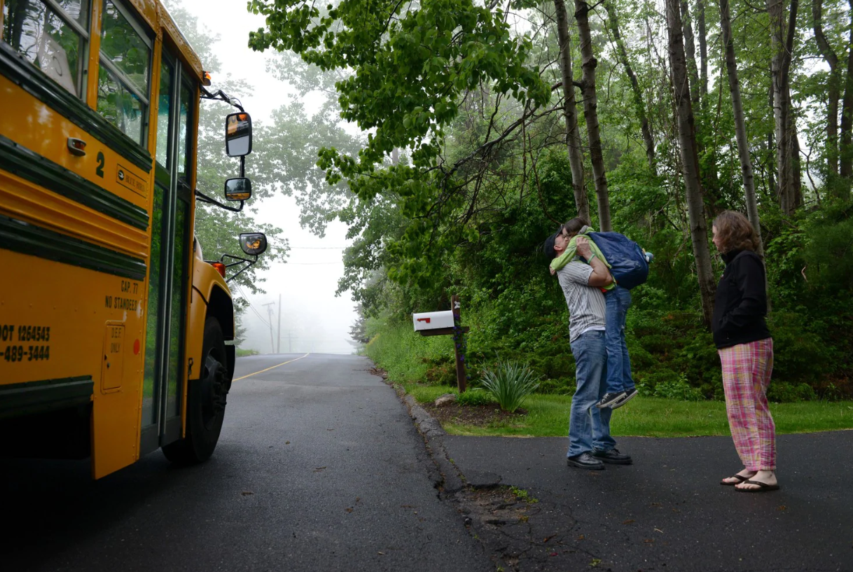 Mark and Jackie Barden hug their 11-year-old daughter, Natalie, before she goes to school in Newtown, Conn., in May.  [Photo: Linda Davidson/The Washington Post]