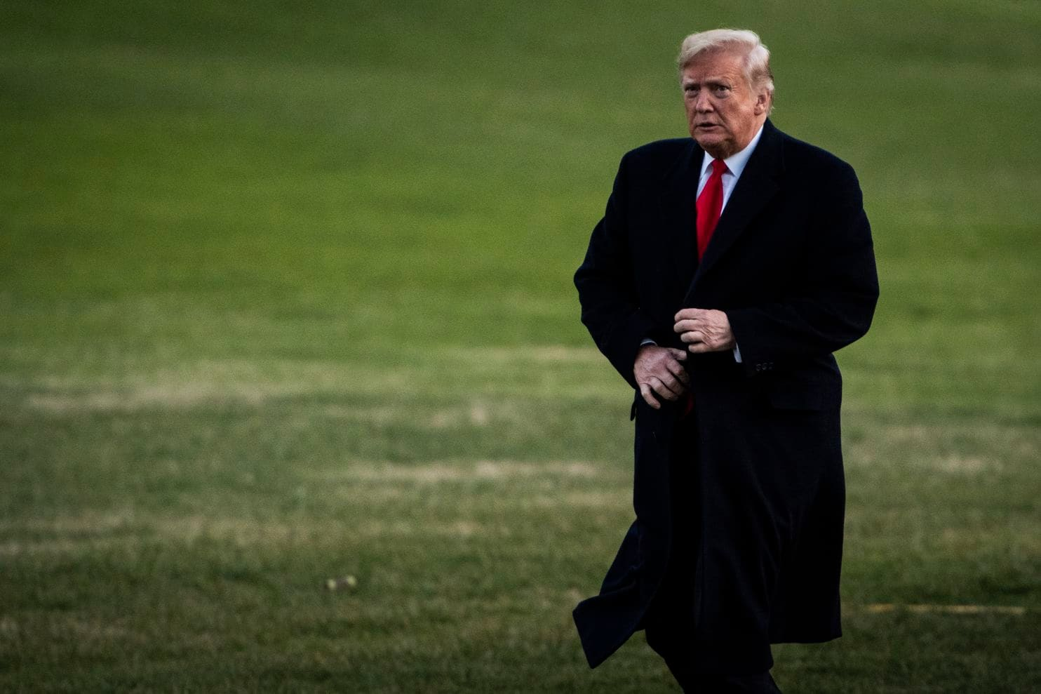 President Trump walks across the South Lawn of the White House on Dec. 7. A person familiar with his schedule said Trump spent more time than usual in his official residence this week.  [Photo: Jabin Botsford/The Washington Post]