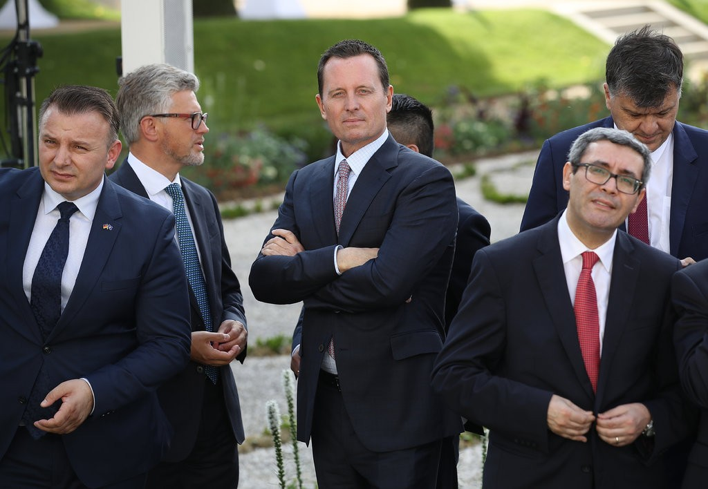 Richard Grenell, center, the American ambassador to Germany, has been an outspoken advocate for the Trump administration since taking his post in Berlin in May.  [Photo: Sean Gallup/Getty Images]
