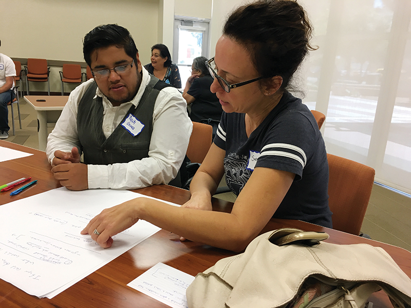 Two participants of the 32 Percent Project converse at a workshop in Pico Rivera, Calif.  [Courtesy Photo]