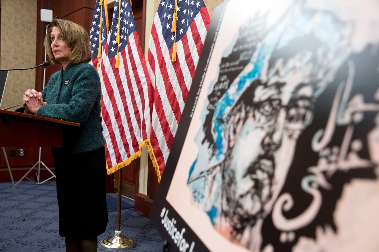 An image of slain reporter Jamal Khashoggi is displayed as House Speaker Nancy Pelosi (D-Calif.) speaks at a Capitol Hill event marking 100 days since the journalist's death, on Jan. 10, 2019.  [Photo: Andrew Harnik/AP]