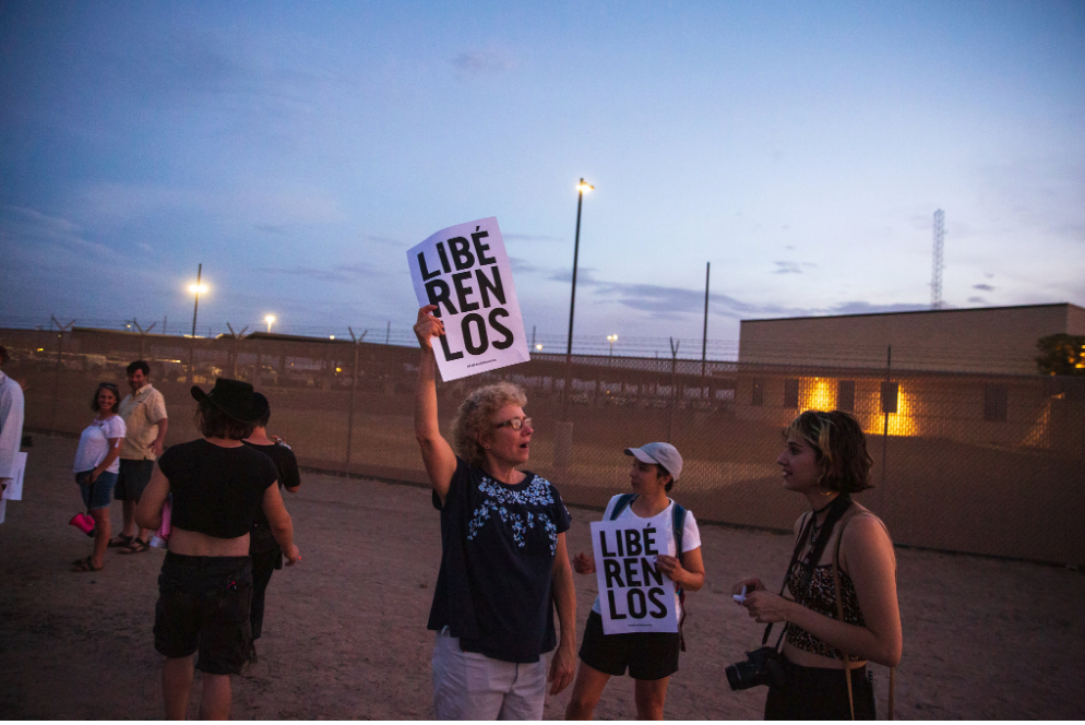 Protesters outside the Clint station on July 4.  [Photo: Ilana Panich-Linsman / The New York Times]