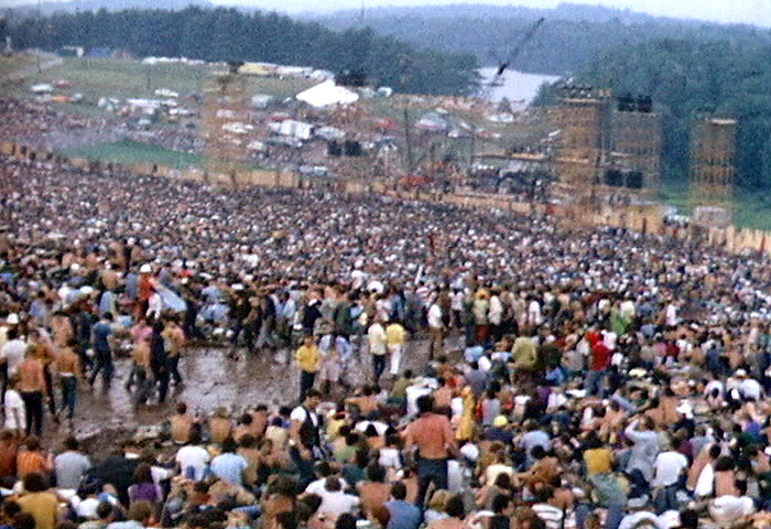 The crowd at Woodstock fills a natural amphitheater with the stage at the bottom.  [Derek Redmond and Paul Campbell / Wikimedia Commons]