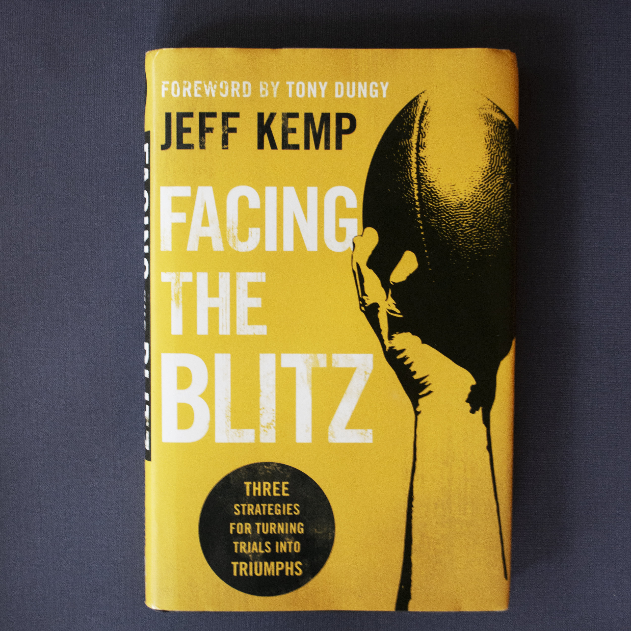 "Facing the Blitz - Jeff Kemp - In football, a ""blitz"" is an all-out attack. Defenses use them to force the quarterback into a mistake and create mayhem and destruction. But by its nature the blitz also creates an opportunity for the quarterback and his team. What looks like the worst play can become the best.During a life ""blitz,"" when everything seems like it's collapsing–financially, relationally, spiritually, or physically–if you take initiative you can do more than just survive. You can grow, succeed, and advance. In Facing the Blitz, Jeff Kemp shares lessons he's learned through all kinds of life blitzes, both personal and professional. Readers will discover how triumph is about transformation and being others-oriented; having the right mind-set can turn unnecessary fear and misery into courage and joy.Learn more on Jeff's website: www.facingtheblitz.com"