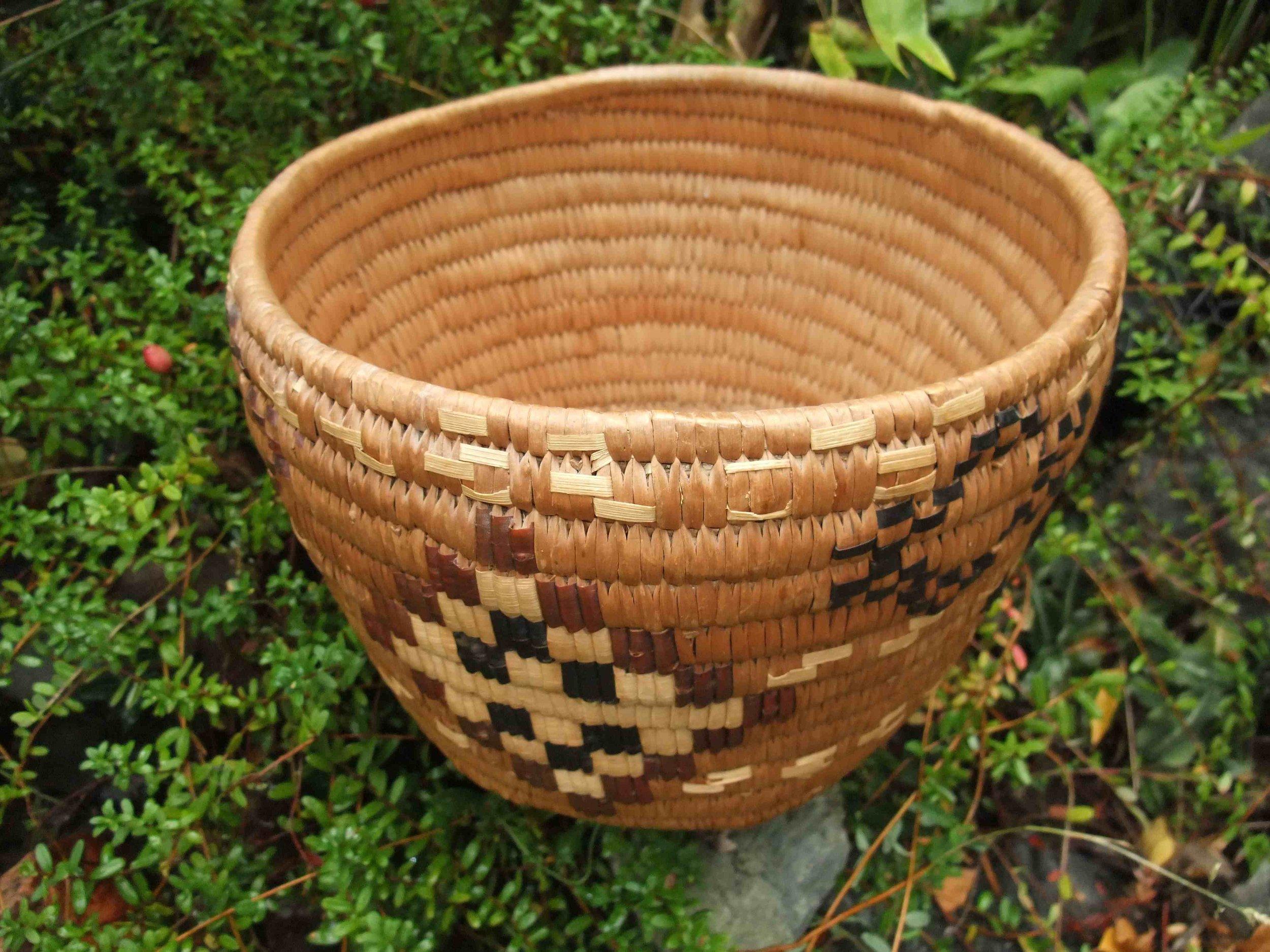 Coiled cedar root basket