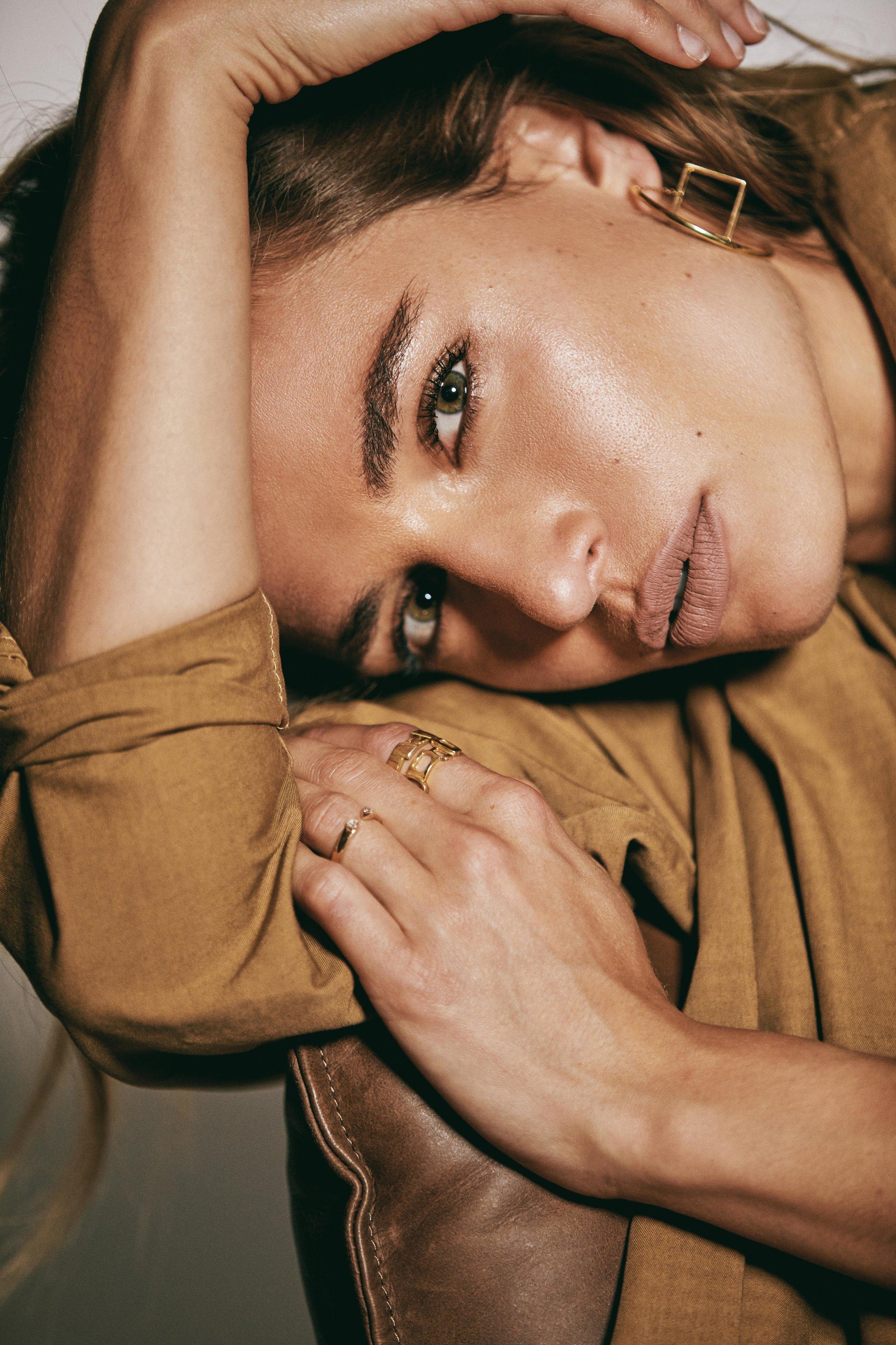Earrings by Pina Studio; Rings by Pina Studio; Ring by Shahla Karimi