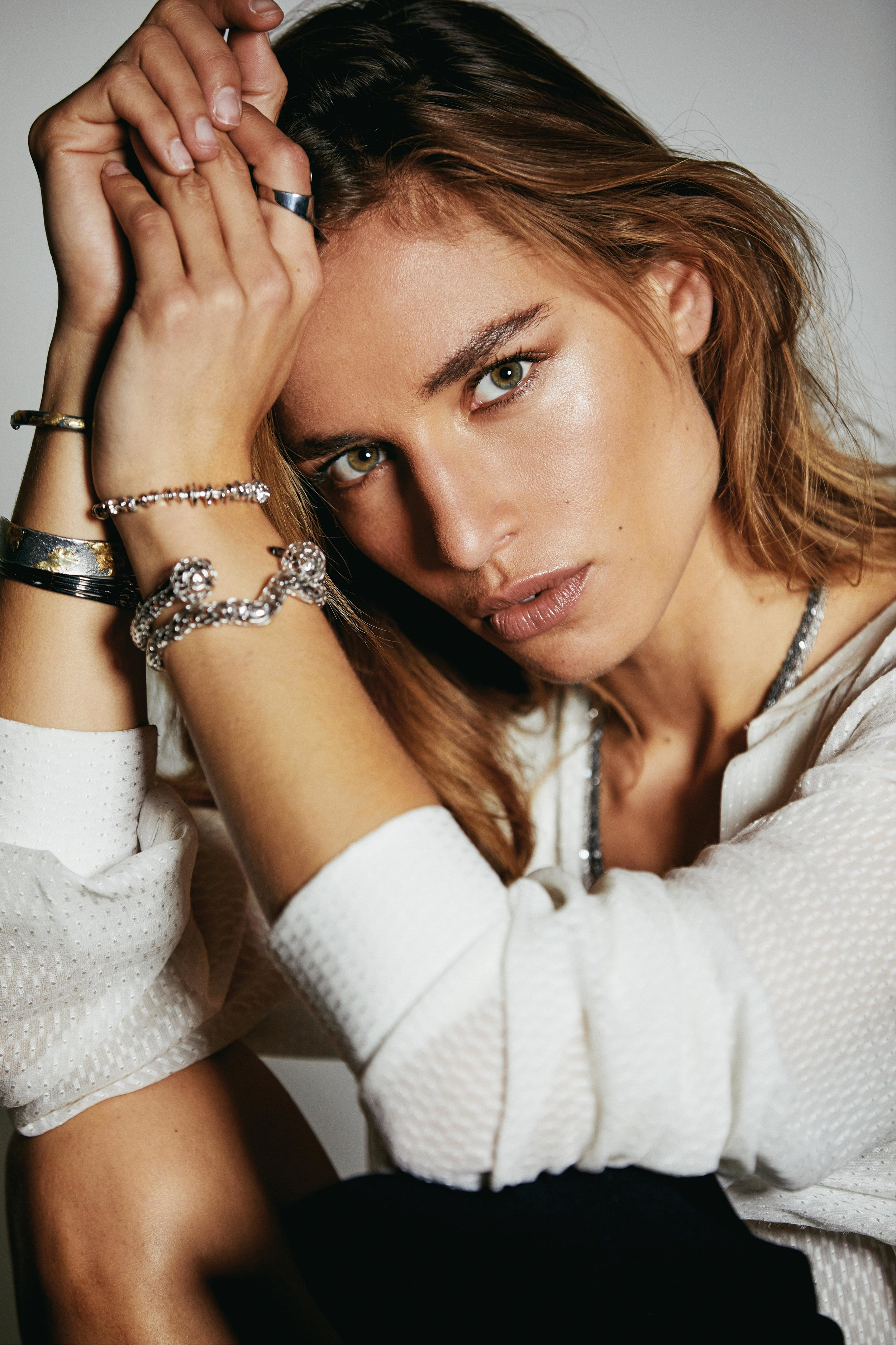 Cuffs by Vitae Ascendere; Cuffs by 602 Lab; Cuffs by Baharra NY; Necklace by Vitae Ascendere; Ring by 602 Lab; Anklet by Baharra NY