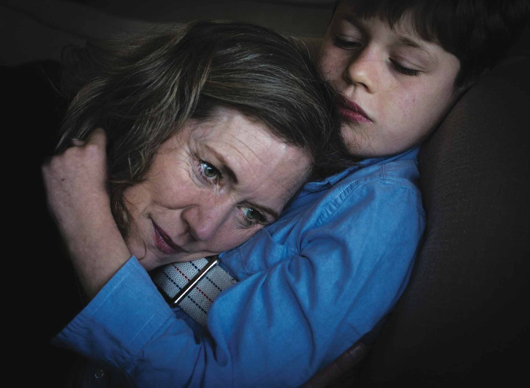 Catherine Jacobson and her son, Ben, at home in Mill Valley, Calif. His seizures have left him with very little ability to communicate, but one of his main ways of showing affection is hugging his mother's head close to his chest. September Dawn Bottoms for The New York Times