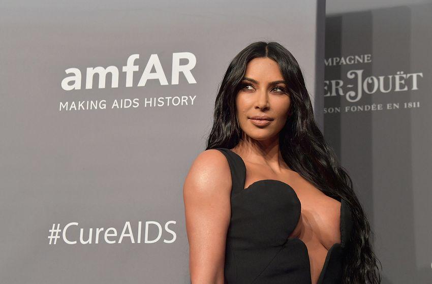 Kim Kardashian attends the annual amfAR charity event. #cureaids