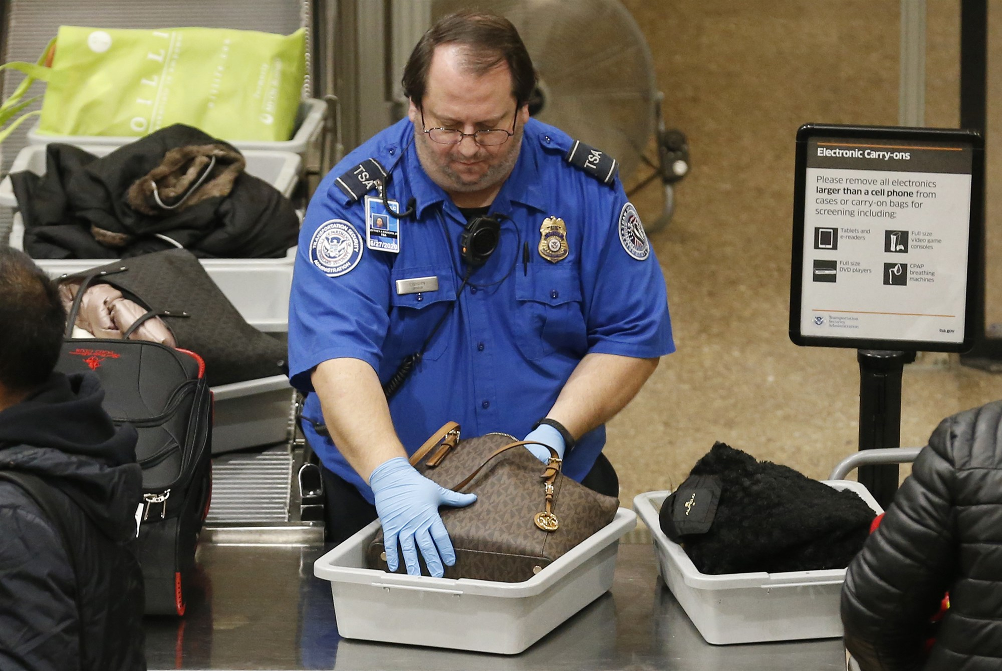 A TSA worker at the Salt Lake City International Airport on Jan. 16, 2019.Rick Bowmer / AP file