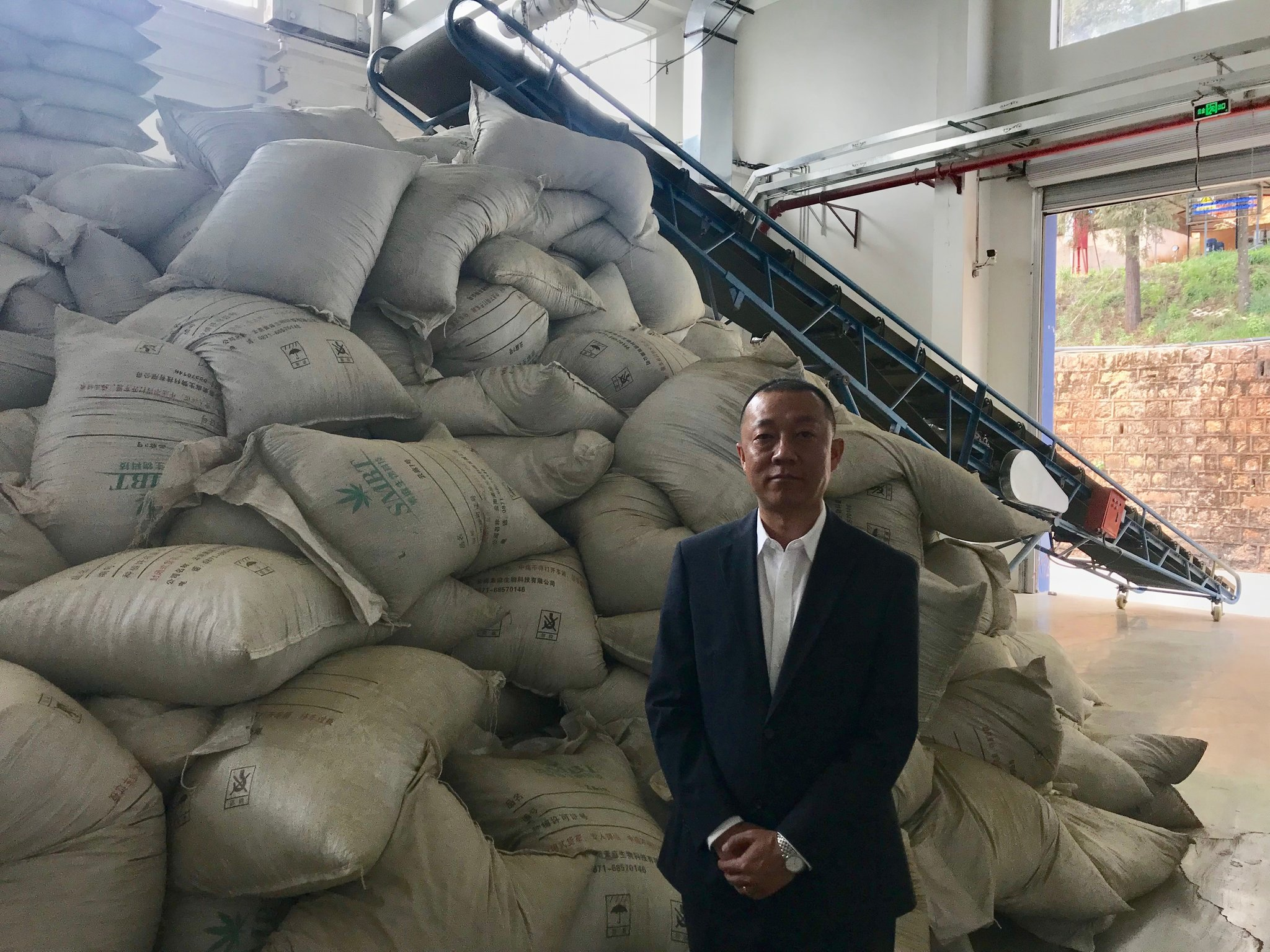 "The company Hempsoul extracts cannabidiol from the hemp it grows on more than 1,600 acres in Yunnan Province. ""It is very good for people's health,"" said the general manager, Tian Wei.CreditSteven Lee Myers/The New York Times"