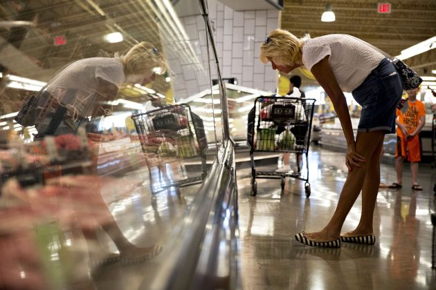 A shopper browses the fresh meat case at a Kroger-owned store in Orland Park, Illinois.    Daniel Acker | Bloomberg | Getty Images