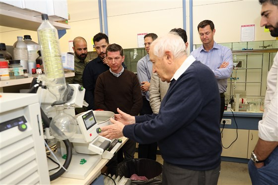 """Raphael Mechoulam explaining the steps of the synthesis of stable CBD acid at his lab at Hebrew University in Israel. Mechoulam was the first to synthesize THC and discovered the endocannabinoid system, leading to the nickname """"father of cannabis.""""Daniel Fine / EPM"""