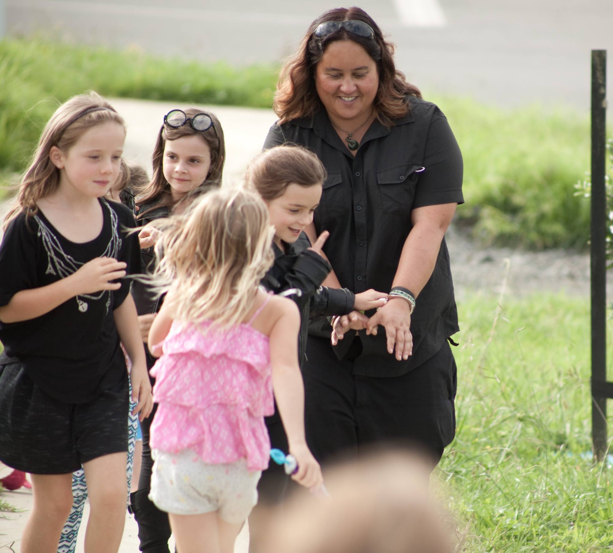 Debbie - Kindest friend- Pictured being arrested by a swarm of kids. The person you know will be there at your side. Scanning magician. Nothing ever seems to be too much to ask.