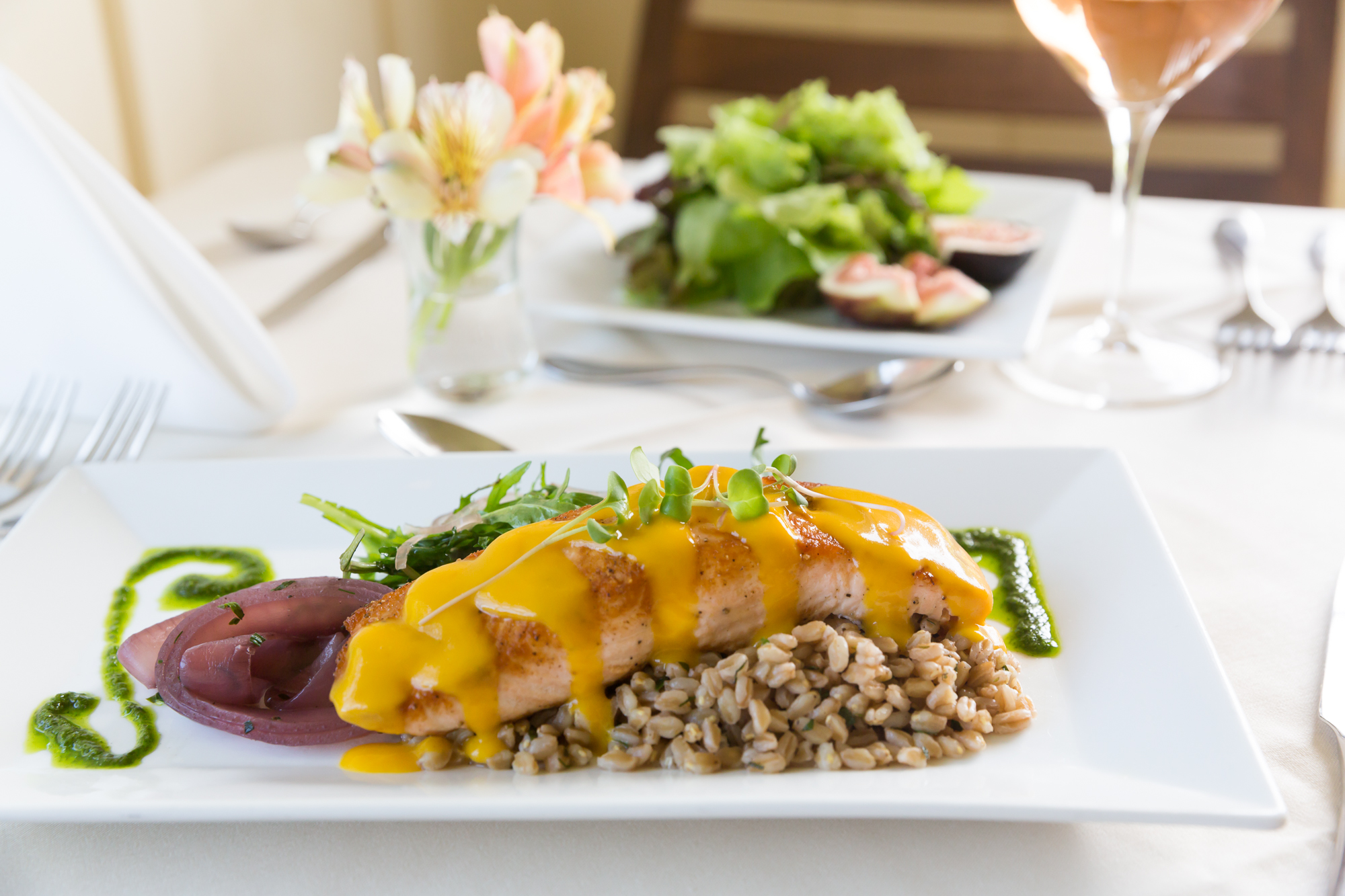 PERSEPHONE  |  Apricot glazed local King salmon with herbed farro, marinated-roasted onions, arugula salad, and fried shallots.