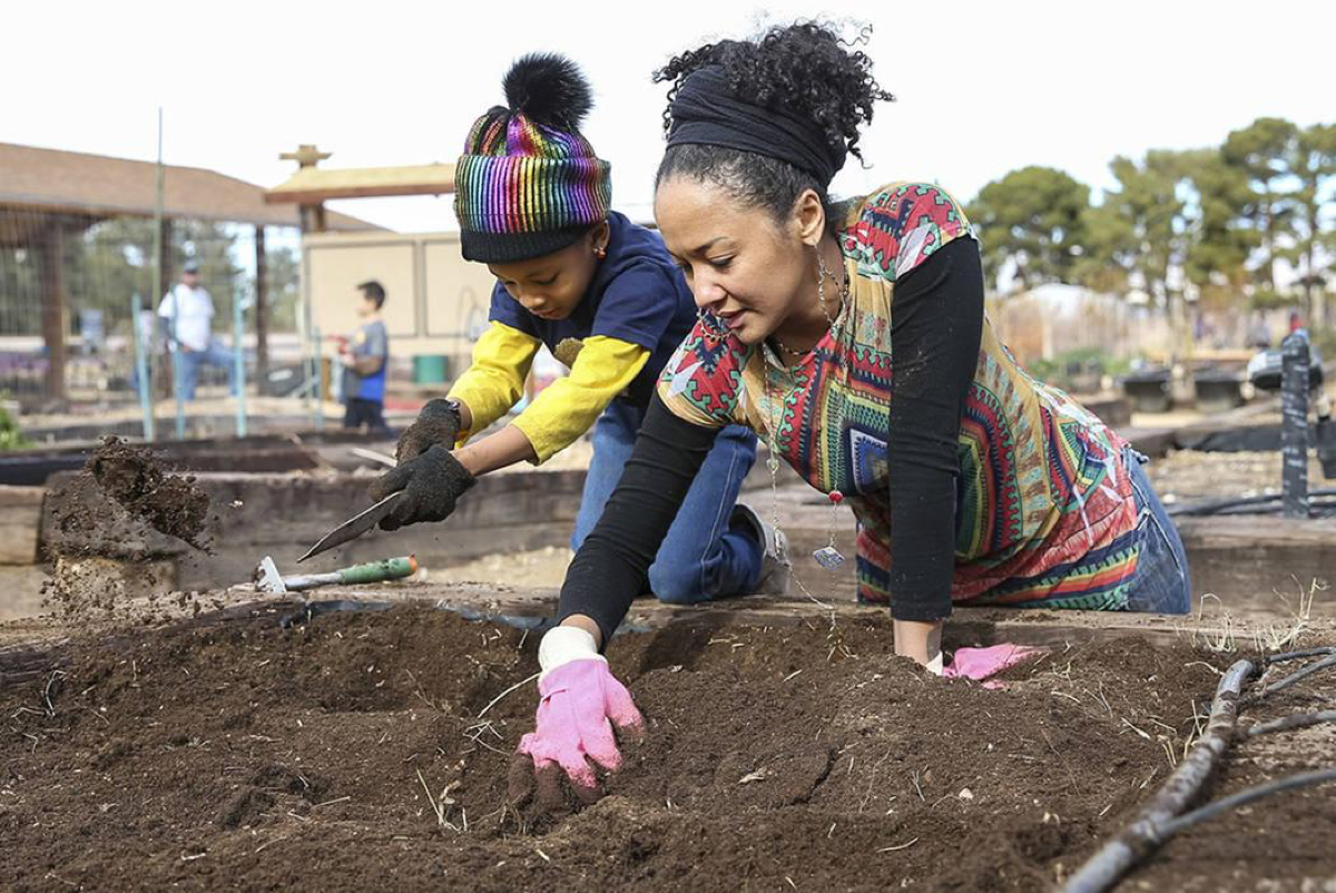 Volunteers Essence Hornick, 7, and her mother, Portia, stir up soil in a garden bed in preparation for early spring planting during a volunteering event at the San Miguel Community Garden located at 3939 Bradley Road in Las Vegas on Saturday, Jan. 12, 2019. Richard Brian Las Vegas Review-Journal @vegasphotograph