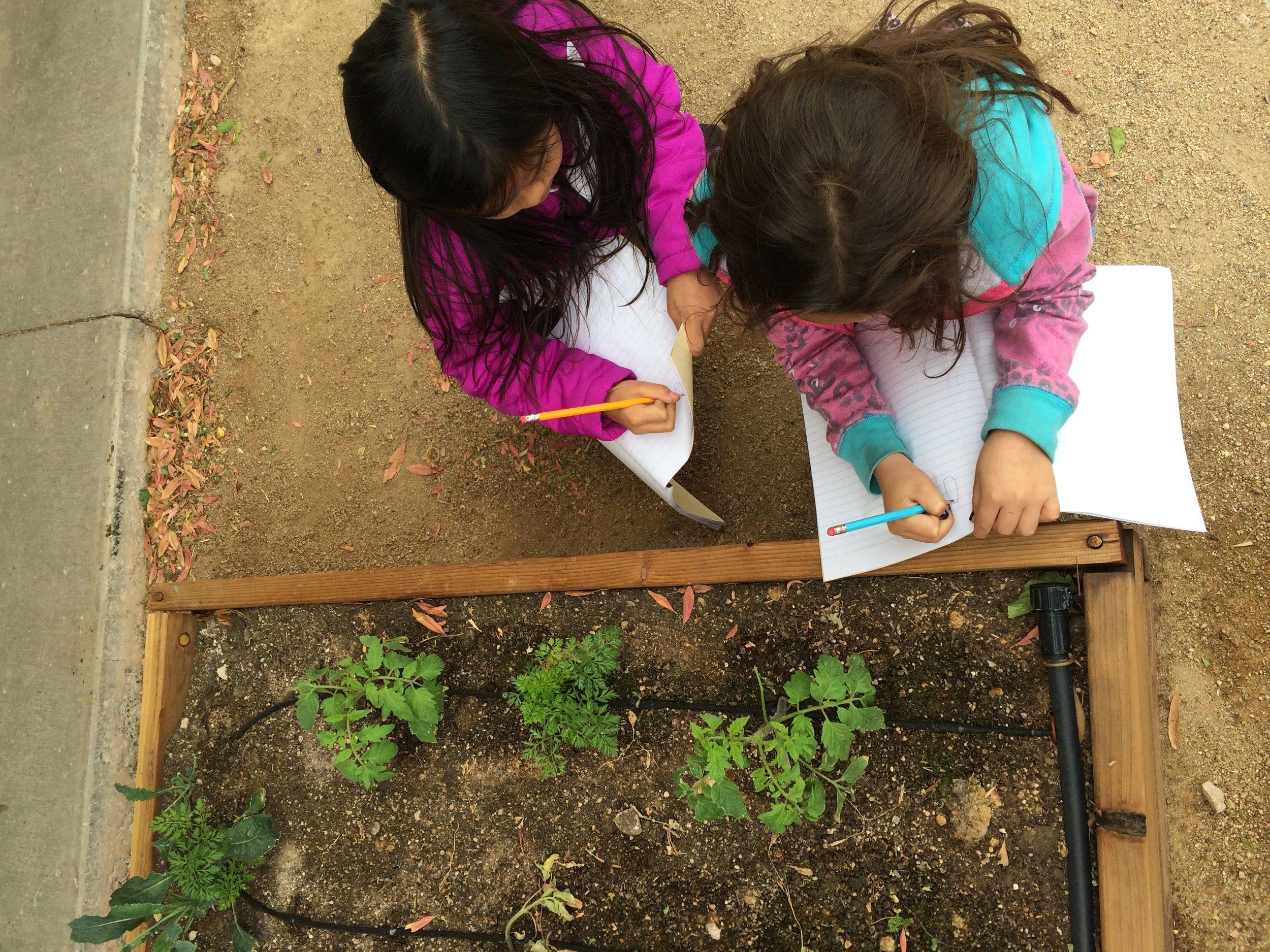 2 girls taking notes.jpeg