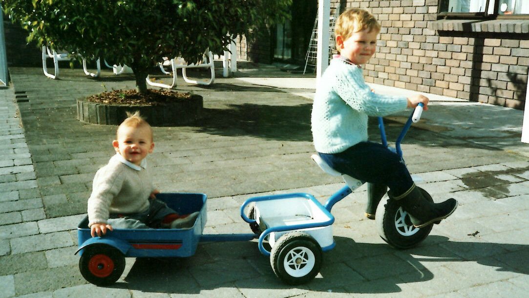 Myself as a child in the 90's towing my younger brother around on one of the iconic children's tricycles that was once made in the factory.