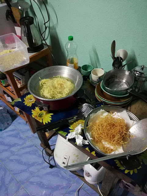 Preparing fried noodles in the wok! The white appliance below is our trusty rice cooker.