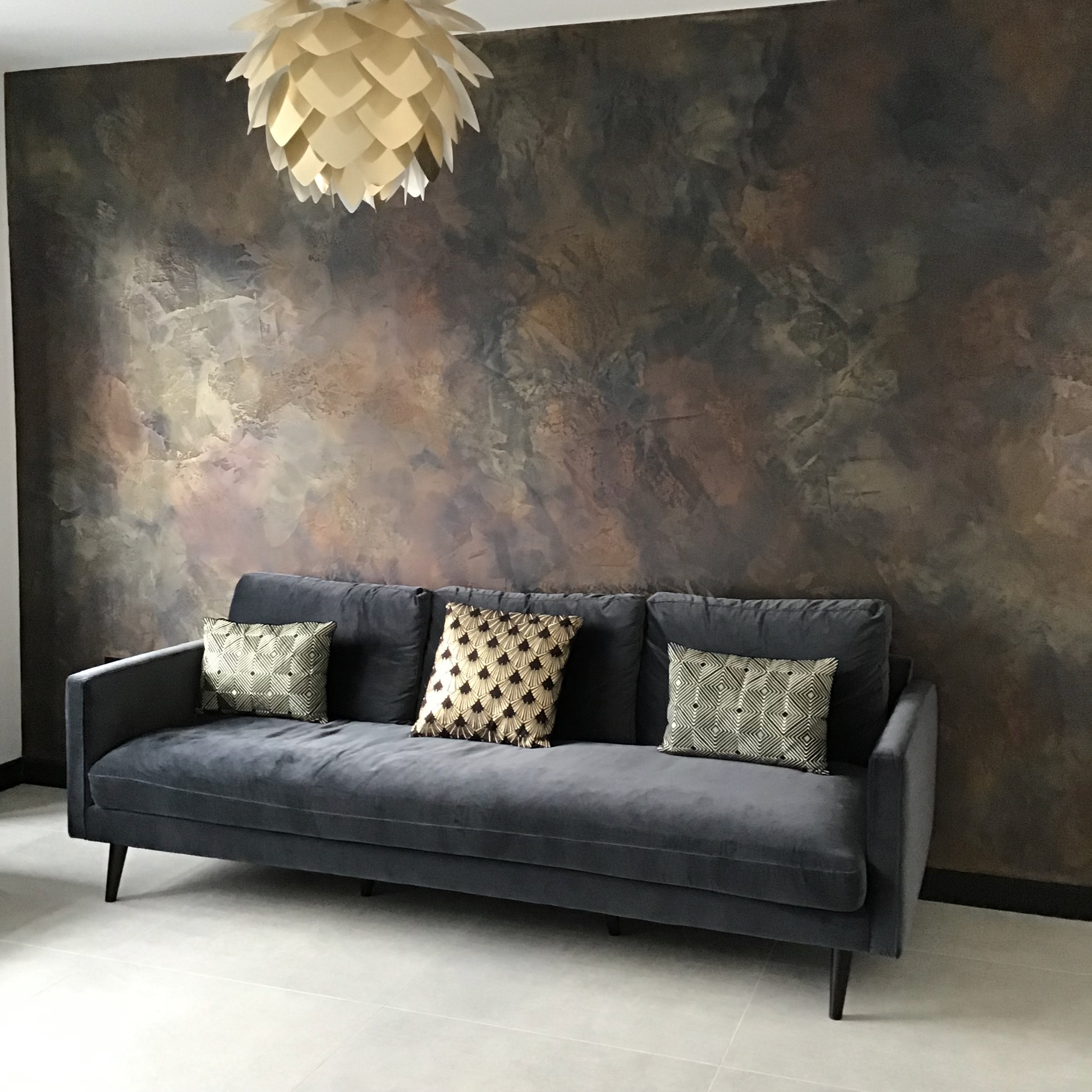 One of our black bespoke polished plaster feature wall with copper, bronze and gold details.