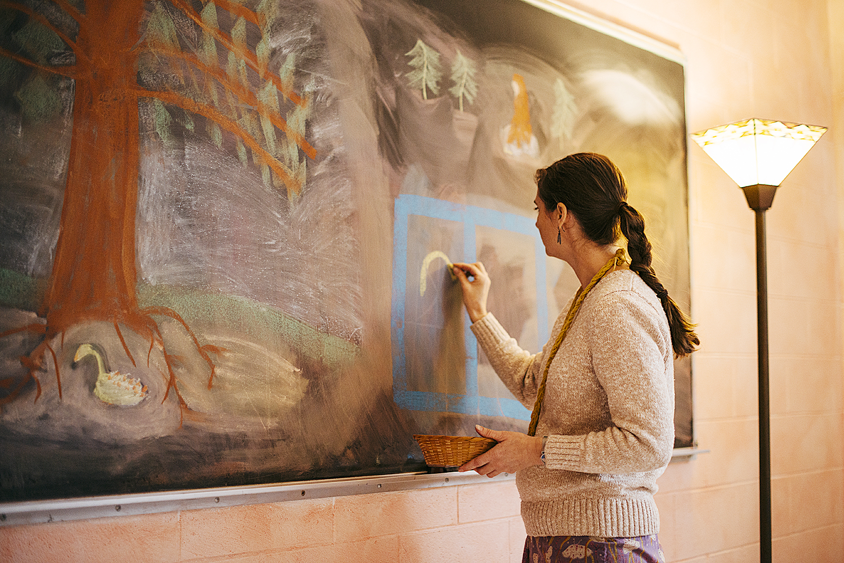 teacher drawing on chalkboard.jpg
