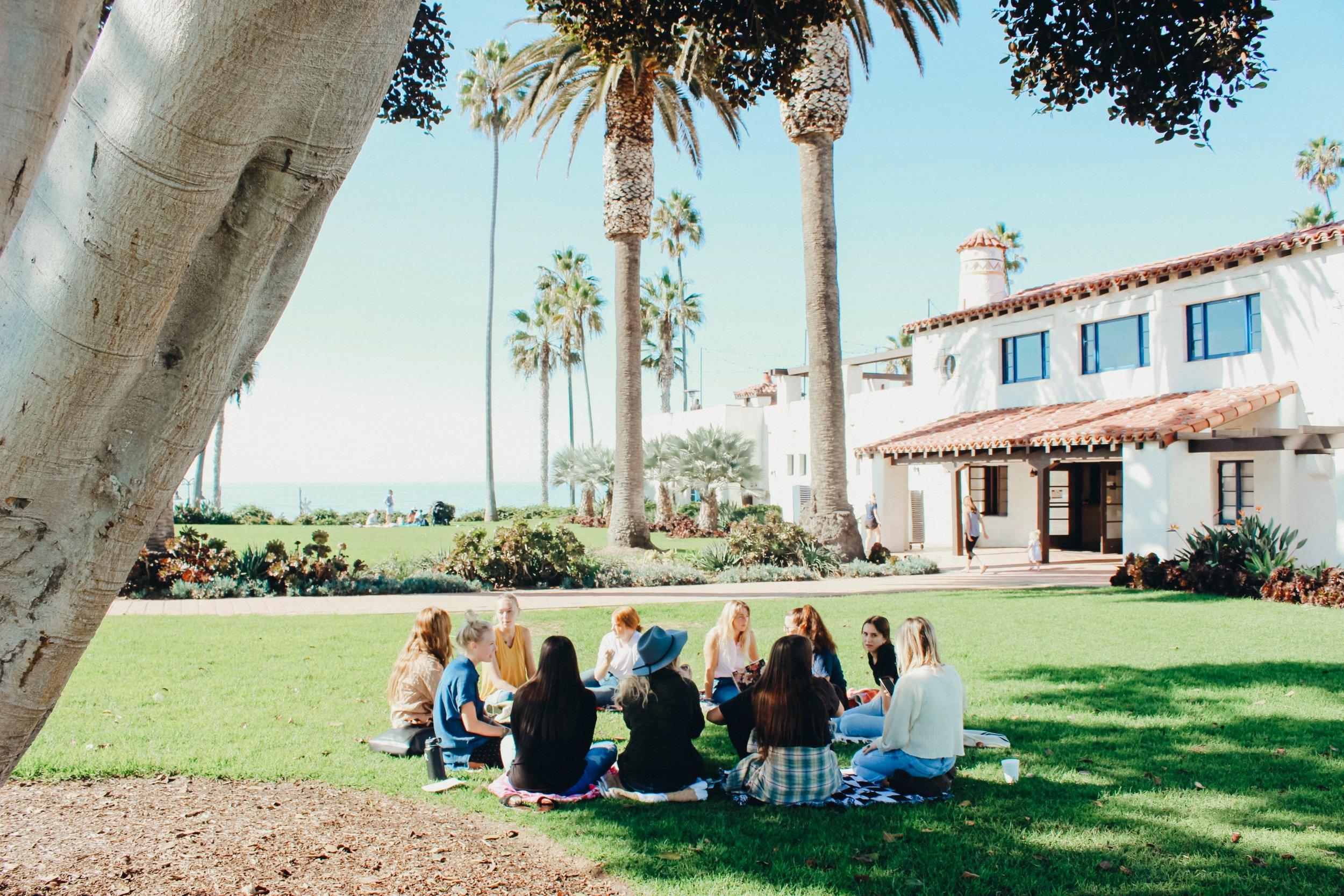 women sitting in circle outside.jpg