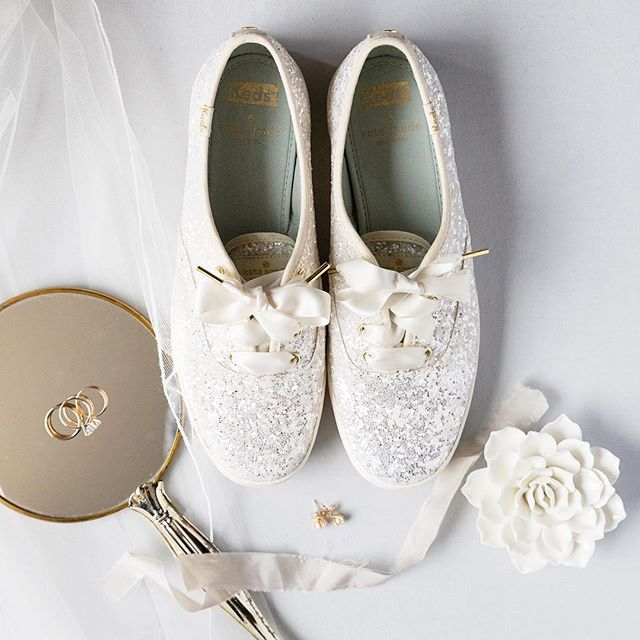 The simple beauty of a brides details . . . . . #thatsdarling #keds #katespade #brideshoes #houstonweddingphotographer #sparkleshoes #katespadekeds #glittershoes #antiquemirror #flatlaystyle #flatlayideas #houstonbride #bridesinhouston #sarahainsworthphotography #weddingrings #bridedetails #weddingsinhouston #goldandglitter #saturdayfeels #houstonphotographer #detailshots