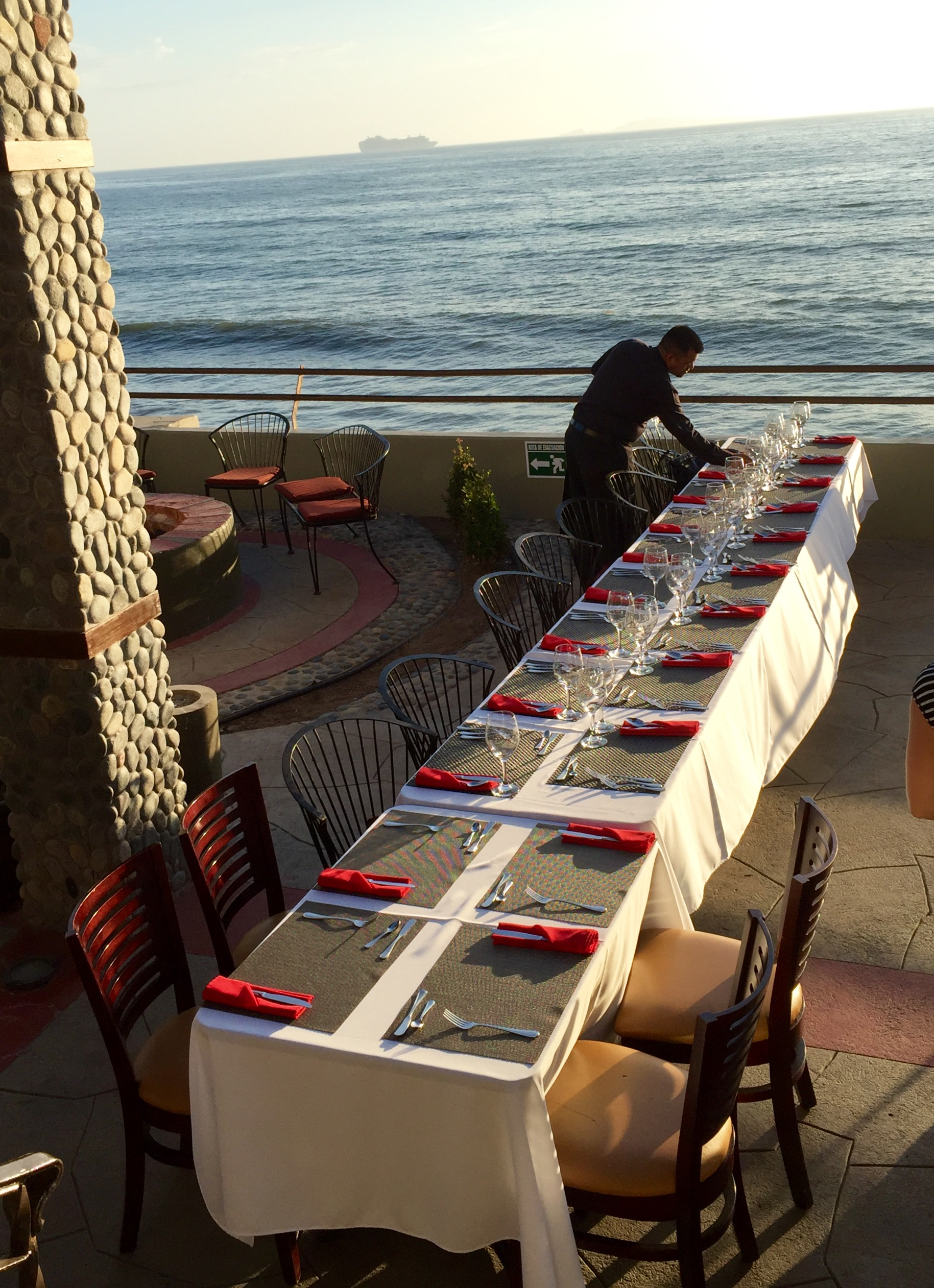 Setting the table for dinner overlooking the ocean at Belio on Sunday night.