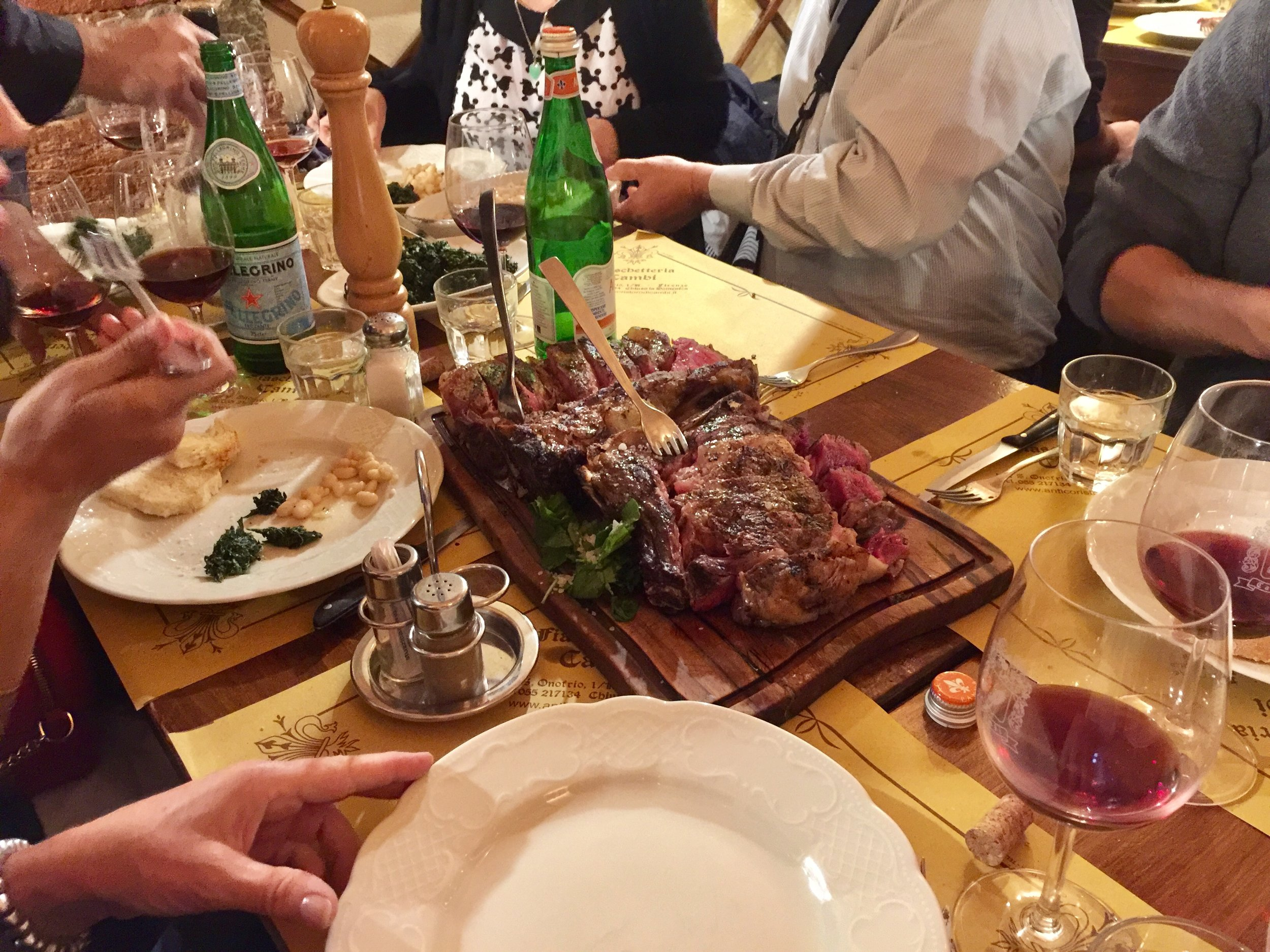 Enjoying bistecca alla Fiorentina (the mother of all steaks) at All'Antico Ristoro di Cambi in Florence on the first night.