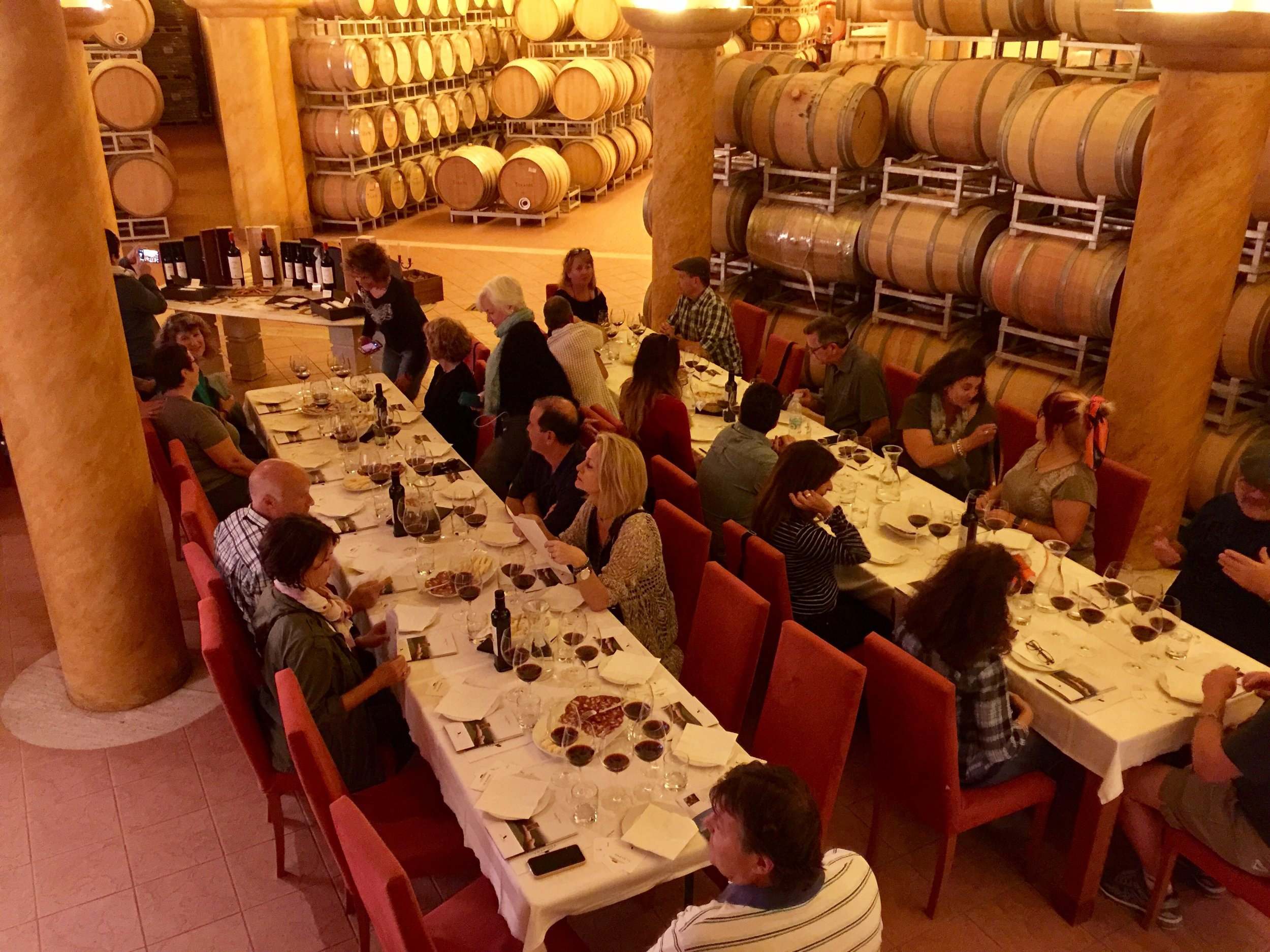 Tasting in the Tolaini winery barrel room.