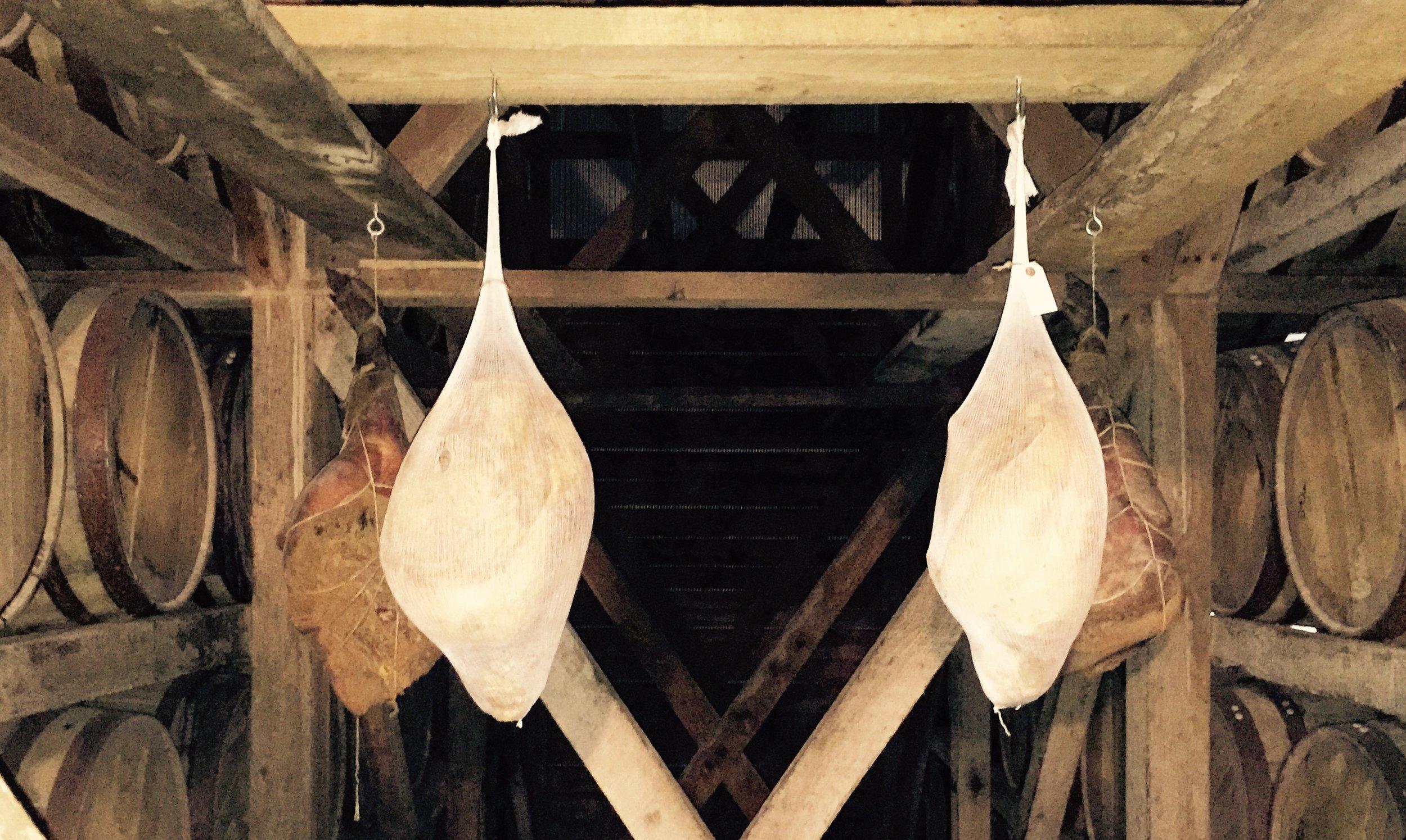 Curing hams in the rickhouses at Willett Distillery