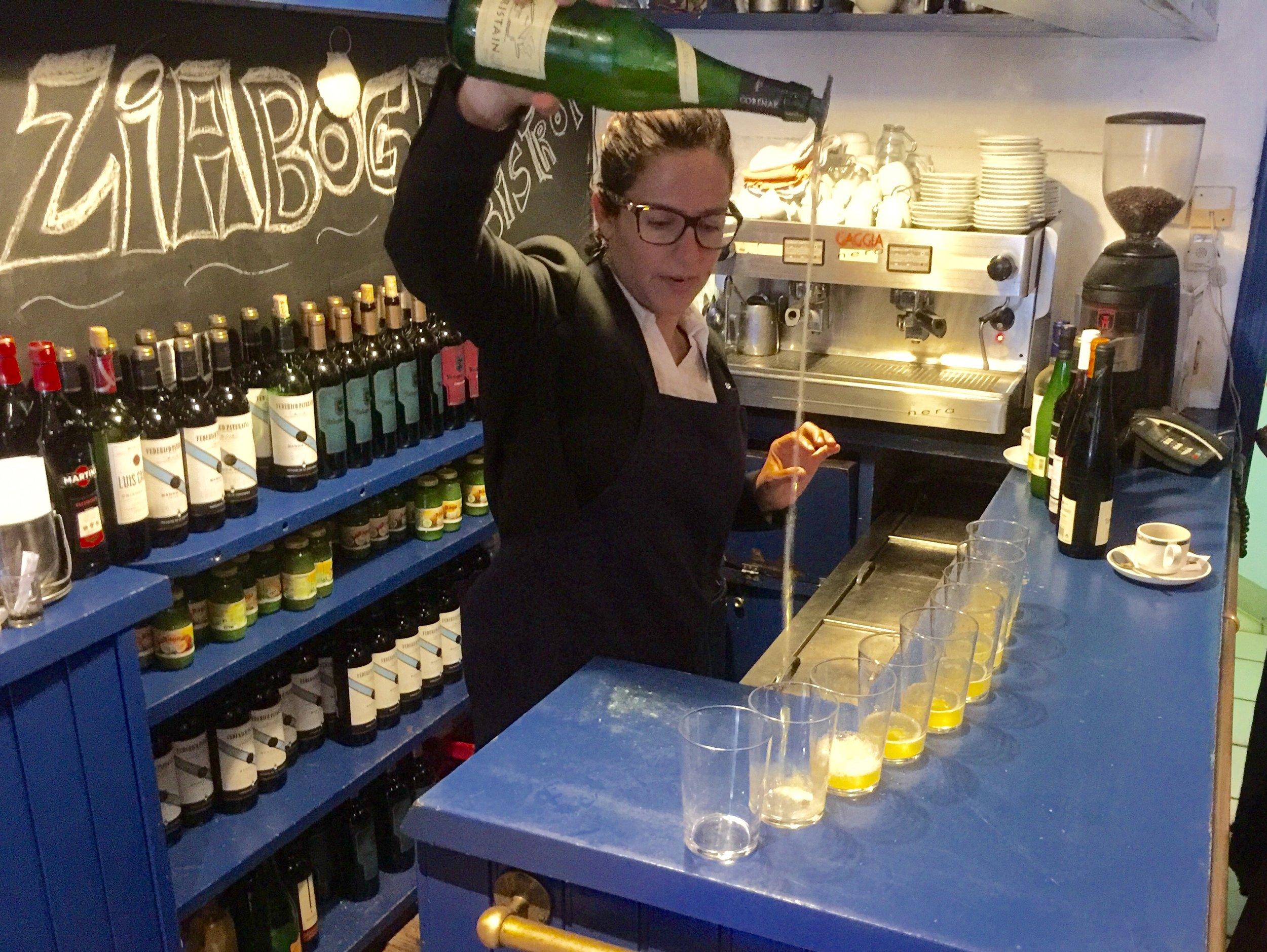 Gabi pouring Basque cider at Ziaboga.