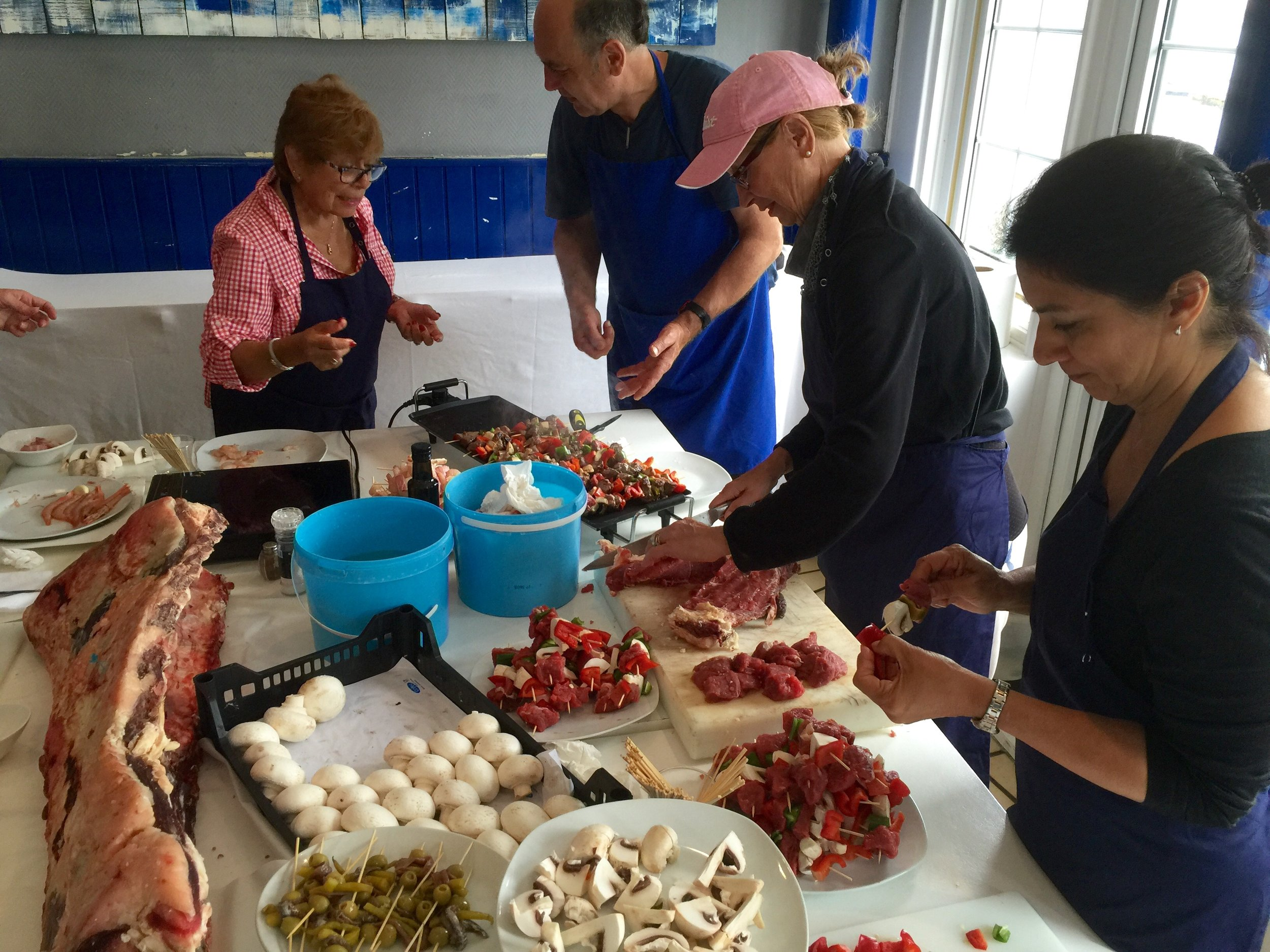Ziaboga transformed their restaurant into a cooking school for us and taught us how to make some Basque classics.  Here everyone is working on making some pintxos ...