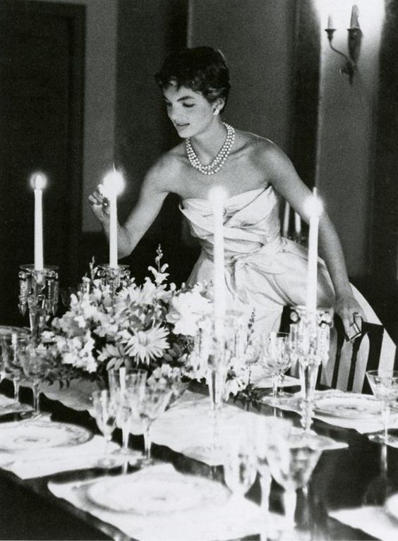 Jackie Kennedy preparing for the young couple's first dinner party at their Georgetown home on Dent Place in May 1954.