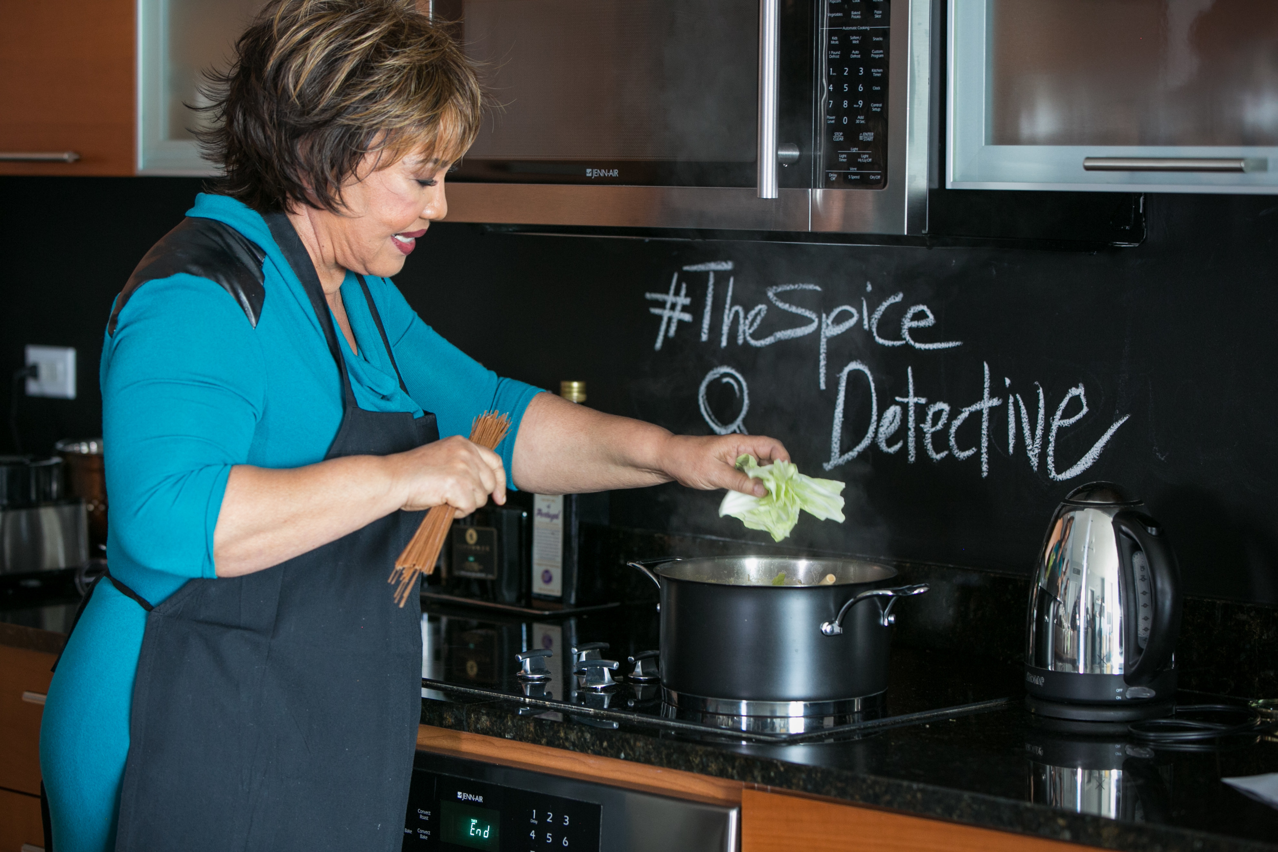 Evelyn Cadet Making Soup Joumou on the Spice Detective.jpg