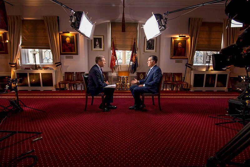 Brian Williams interviews presidential candidate Mitt Romney in London during the 2012 London Olympics (Photo by Anthony Quintano)