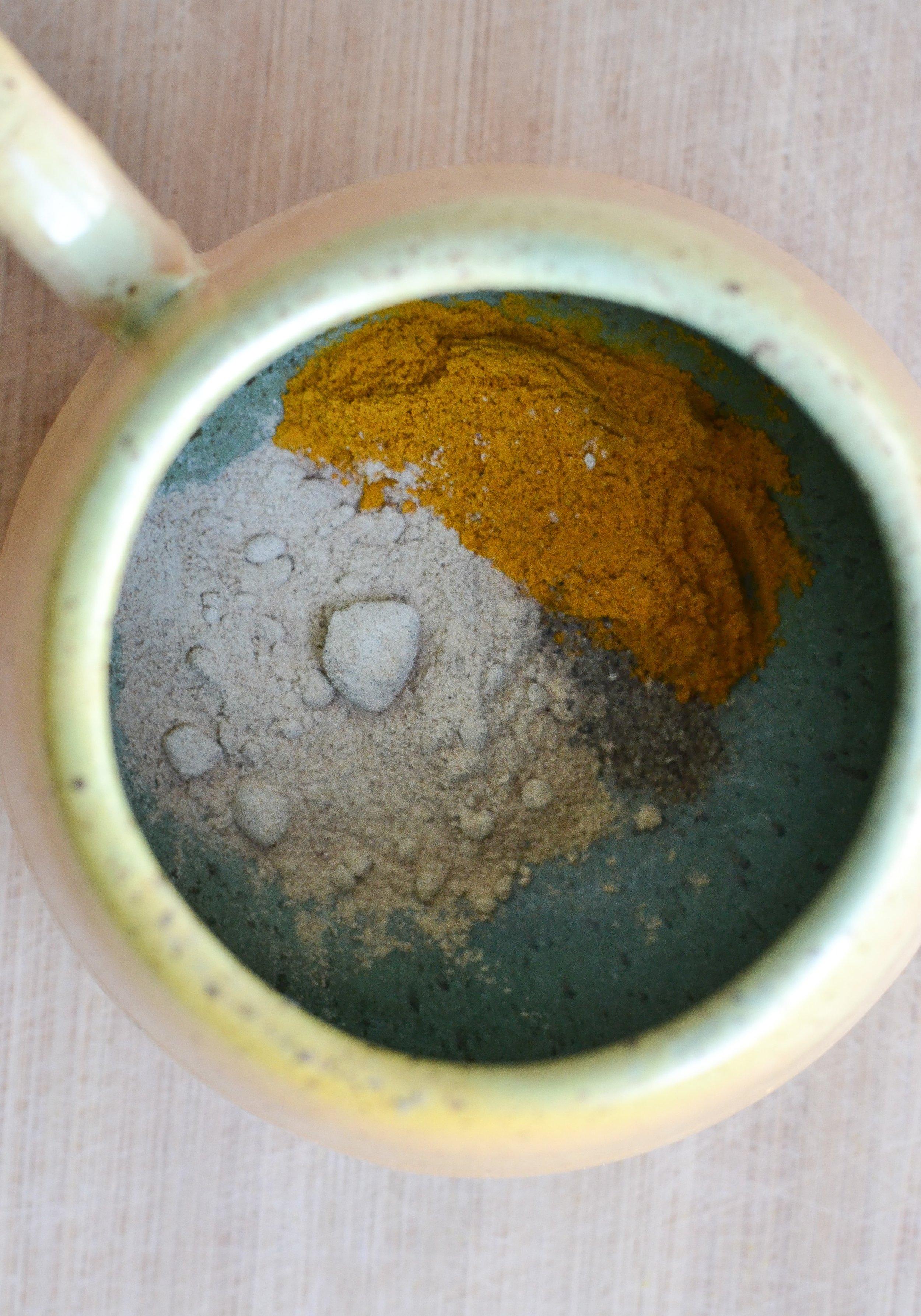 Maca powder, turmeric, and black pepper in mug.