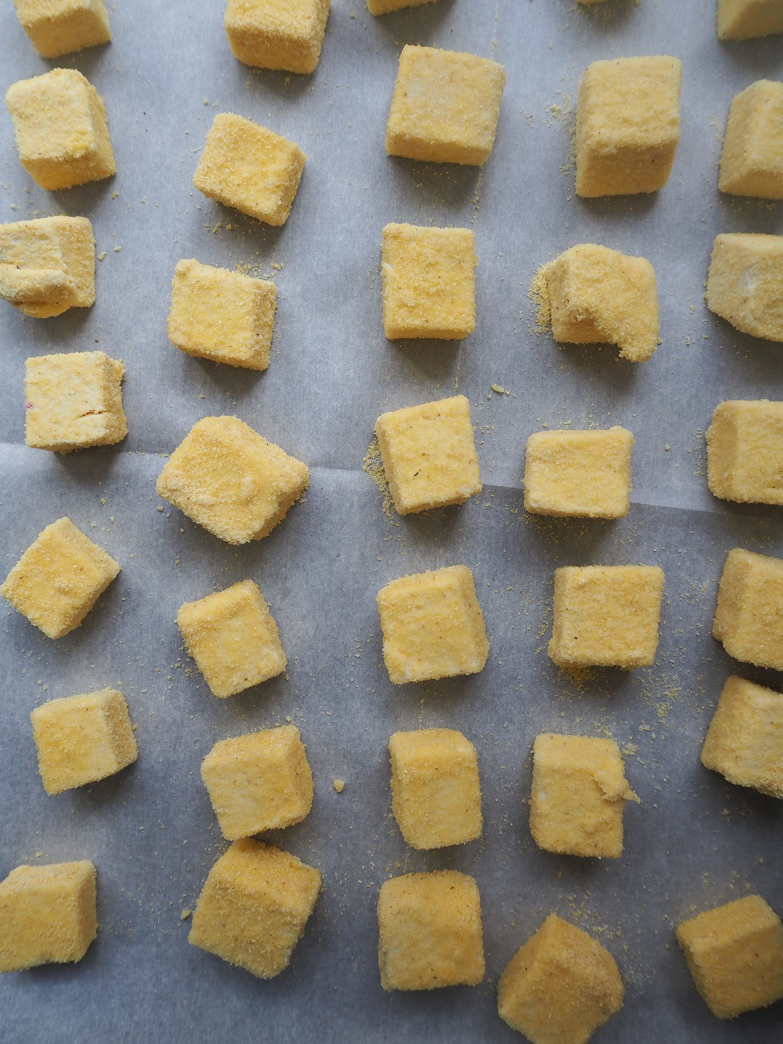 Place tofu on a parchment paper-lined baking sheet.