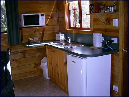 This one bedroom self contained cabin has a its own kitchen with microwave oven, hotplates, fridge and all the cooking utensils you will need for a self catering holiday at Cradle Mountain in Tasmania Australia.