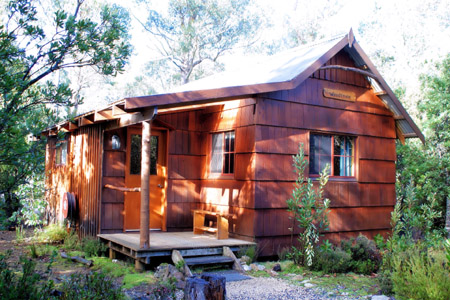 Cosy and secluded double cabin accommodation hidden away in a Cradle Mountain wilderness setting at Cradle Mountain Highlanders Cottages in Tasmania Australia.