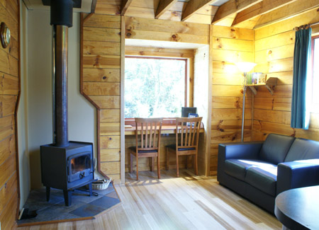 This cosy double cabin has a separate lounge / dining area with recliner chairs. Lay back and relax in the wilderness of Tasmania at Cradle Mountain Highlanders Cottages self contained cabin accommodation.
