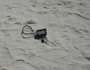 Home inspector finds outlet on beach while on vacation