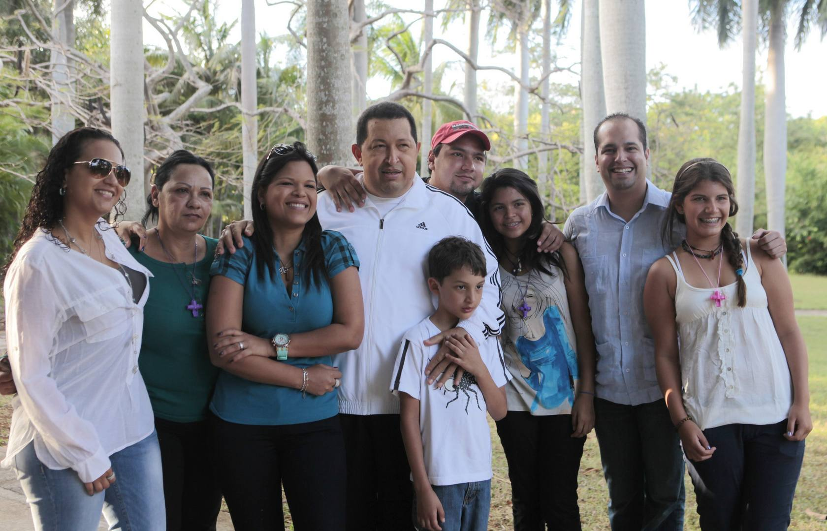 Handout picture taken on March 12, 2012, and released March 13 by the Venezuelan presidential press office showing Venezuelan President Hugo Chavez (C) surrounded by his family during a stroll in Havana. Chavez, 57, had surgery two weeks ago in Havana of a second malignant tumor in the same area that in June 2011 extracted the first, also in Cuba. The president announced that Venezuela will return this week. AFP PHOTO/PRESIDENCIA RESTRICTED TO EDITORIAL USE-NO MARKETING-NO ADVERTISING CAMPAIGNS-MANDATORY CREDIT 'AFP PHOTO/PRESIDENCIA' -DISTRIBUTED AS A SERVICE TO CLIENTS