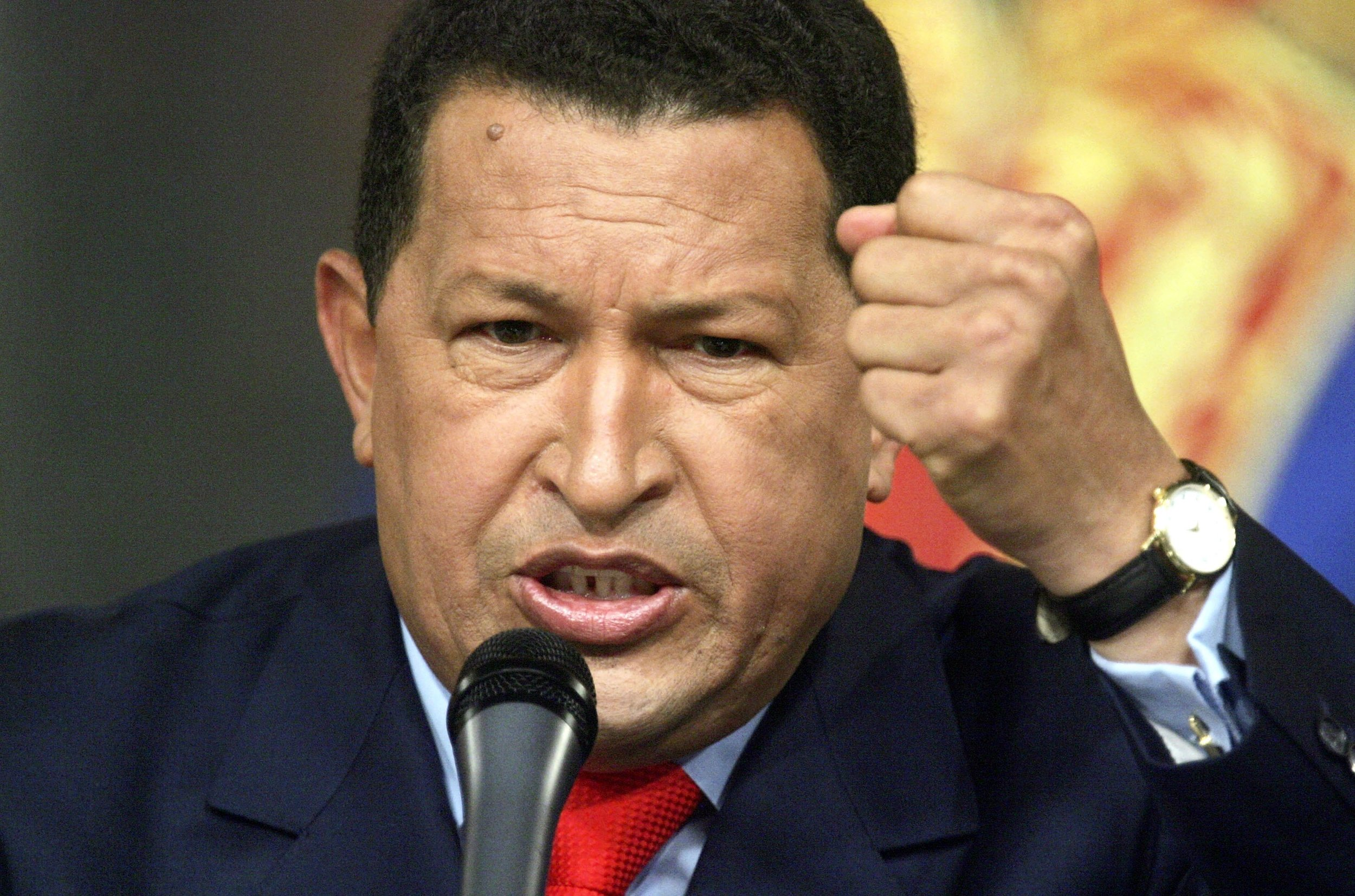 CARACAS, VENEZUELA - DECEMBER 05: Venezuelan President Hugo Chavez speaks at a press conference in Miraflores Palace December 5, 2006 in Caracas, Venezuela. Chavez was officially declared the re-elected president by electoral authorities today after defeating challenger Manuel Rosales in the December 3 election. (Photo by Mario Tama/Getty Images)