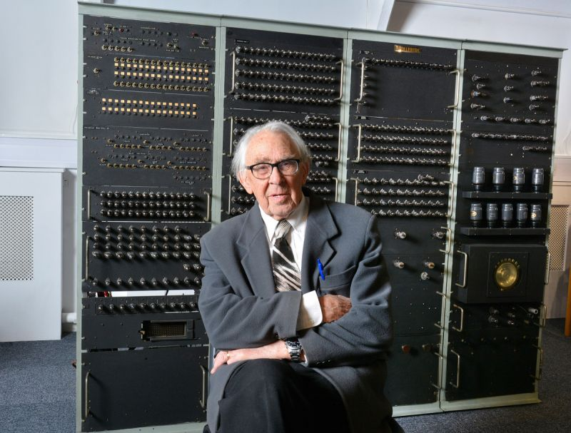 Dr Raymond Bird in front of the machine he engineered more than 60 years ago.