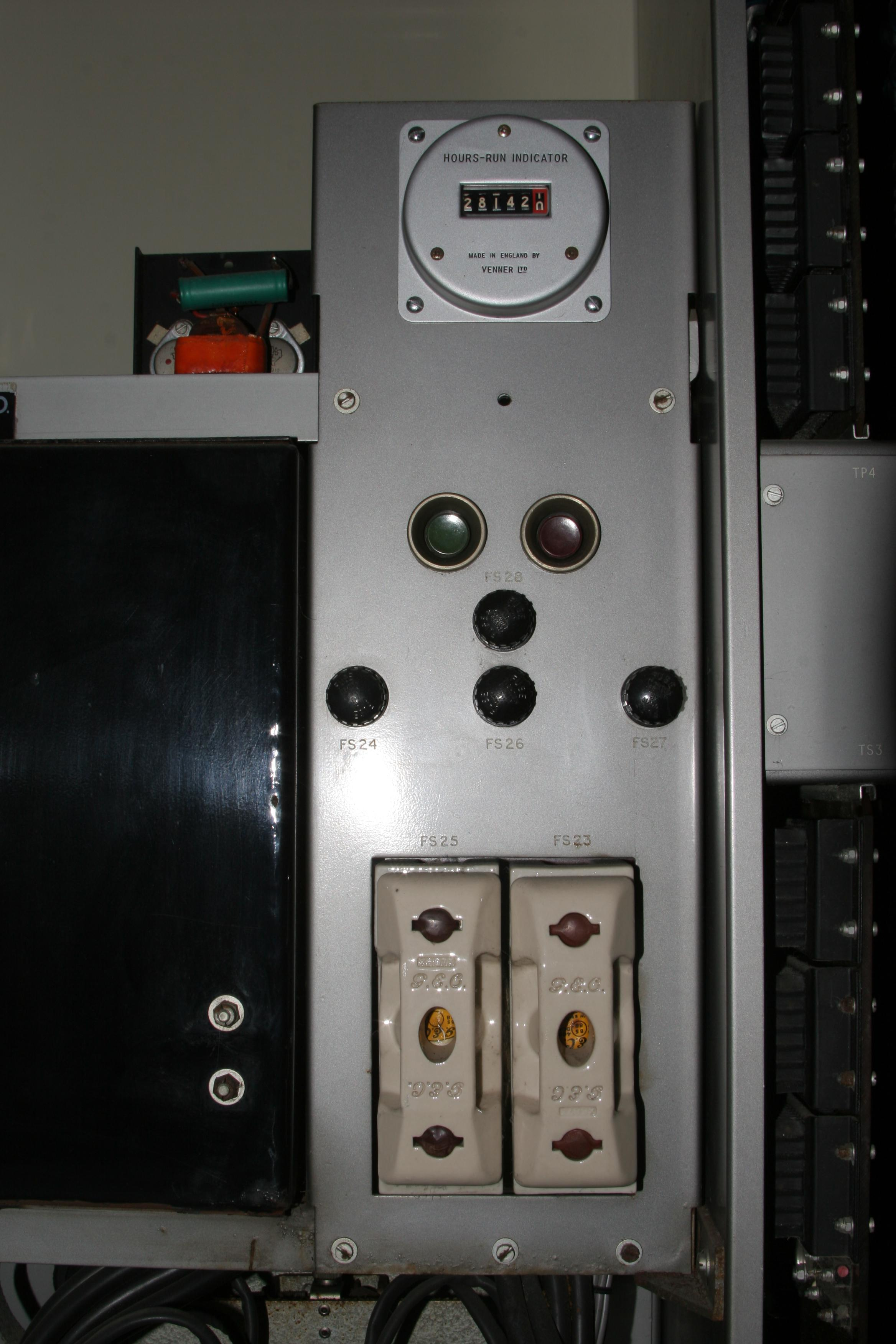 "Fig 3 - ""Hours run"" meter, ON and OFF buttons and fuses in the power cabinet"